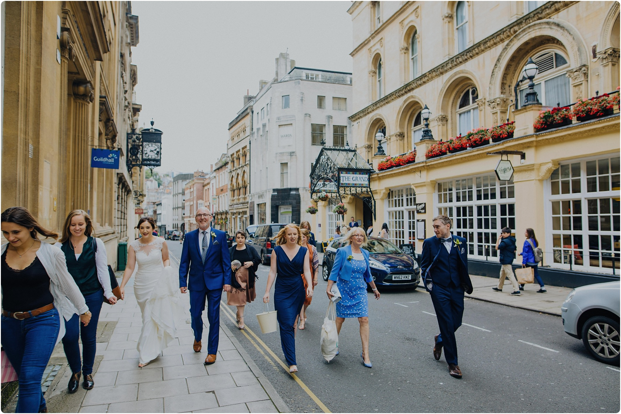 bridal party walking from Grand Hotel in Bristol to City Hall