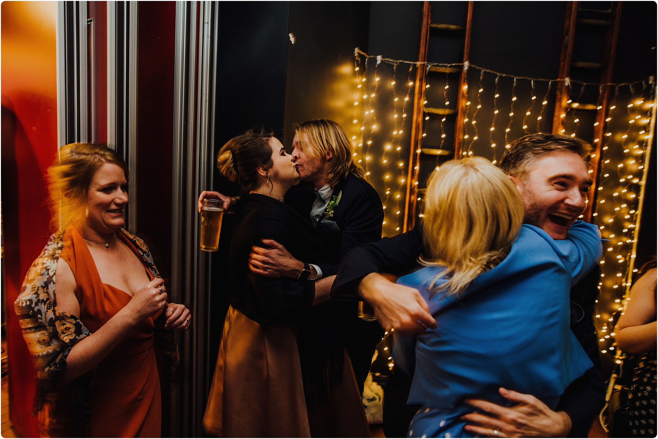 kissing at a a Station Kitchen Wedding