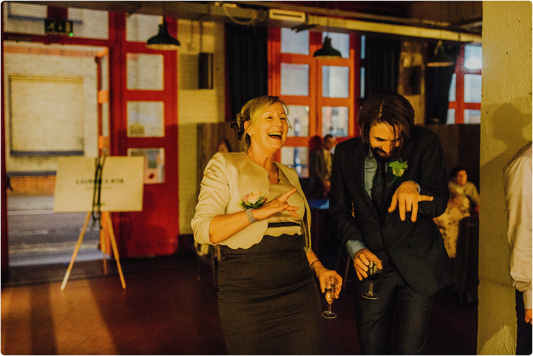 2 guests dancing at a Station Kitchen Wedding