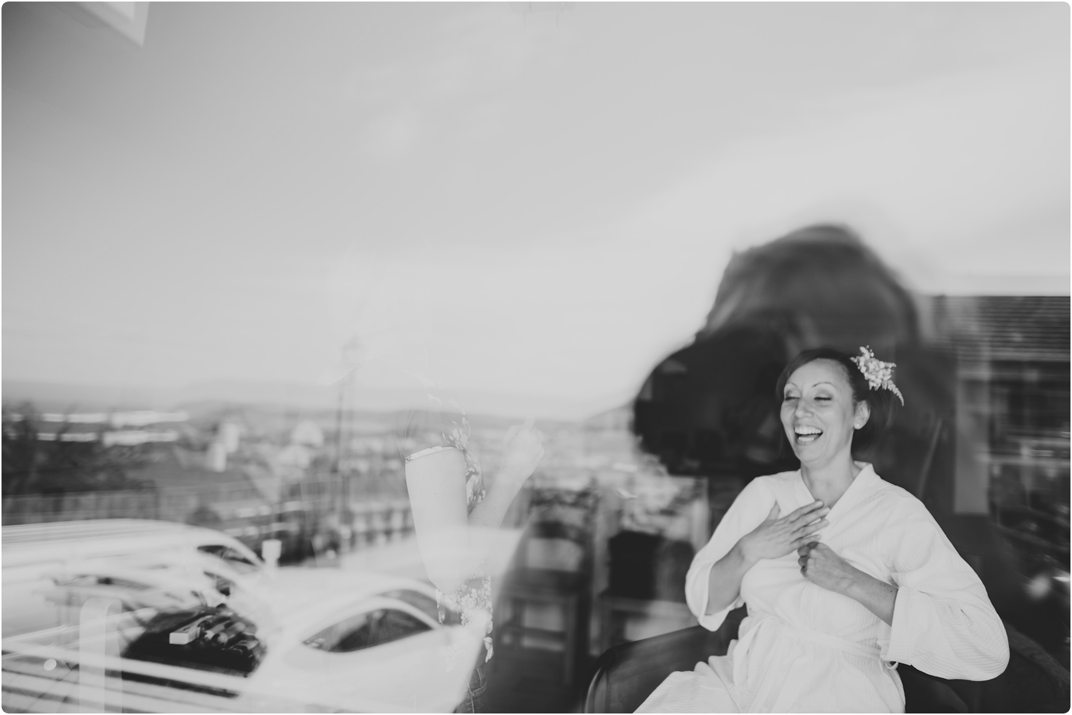 bride laughing in window at woolacombe bay appartments