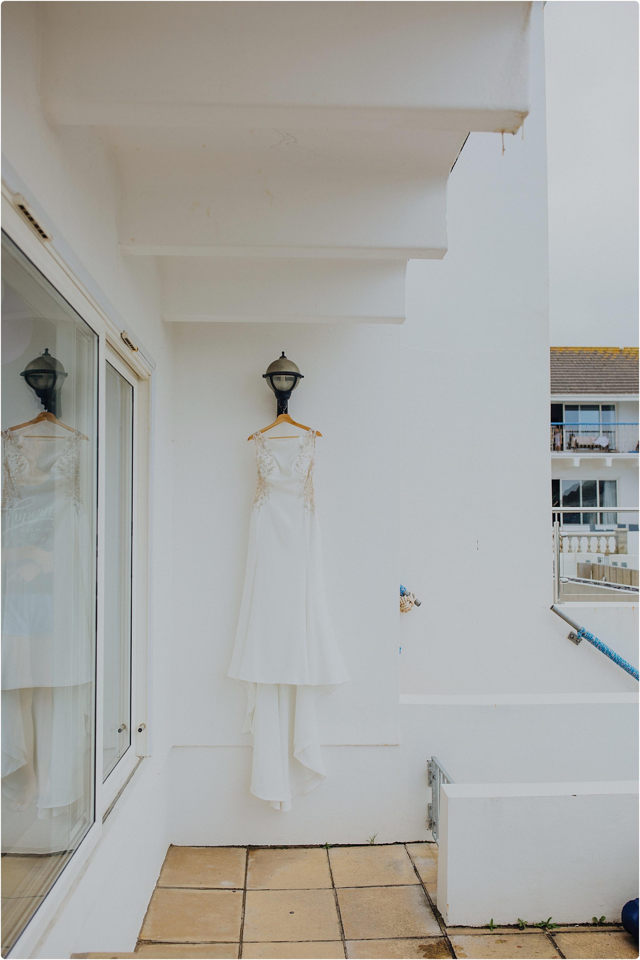 wedding dress hanging outside at woolacombe bay apartments
