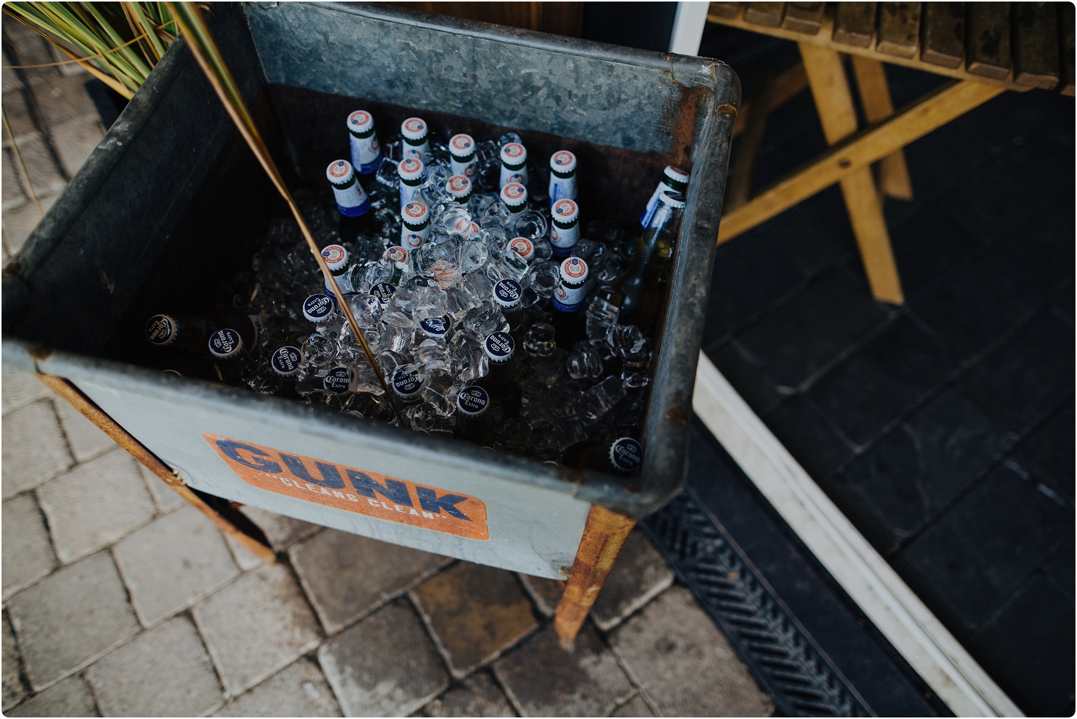 beers in ice at tunnels beach wedding