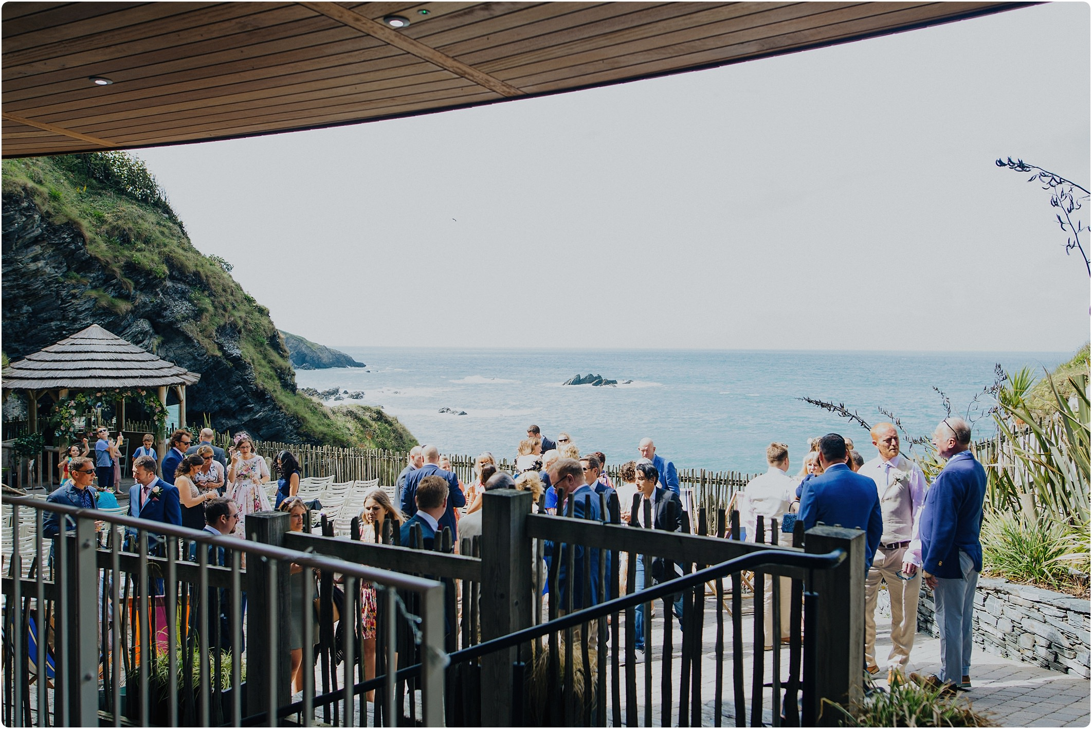 guests chatting before ceremony at a tunnels beach wedding