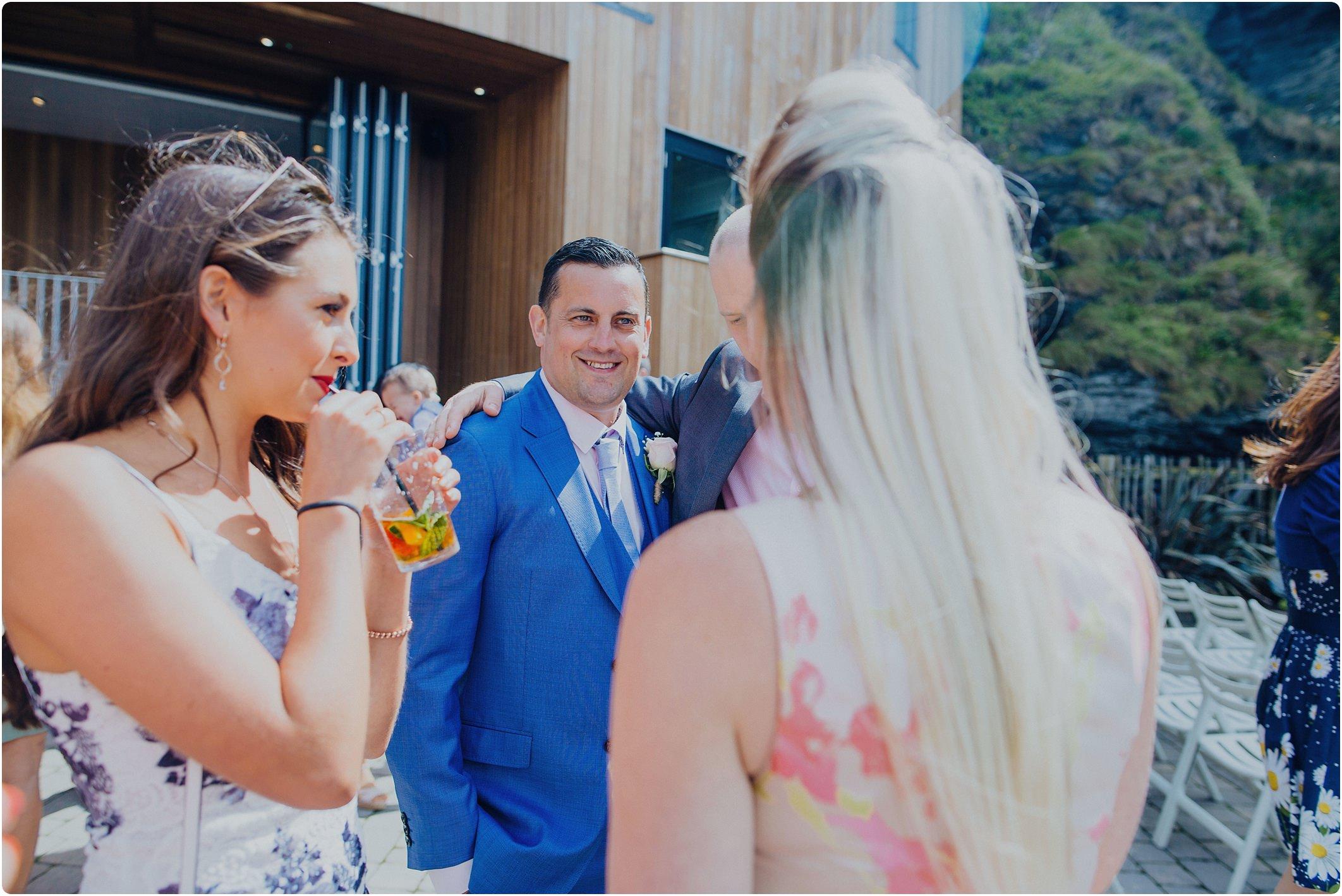 groom in blue ted baker suit at a tunnels beach wedding