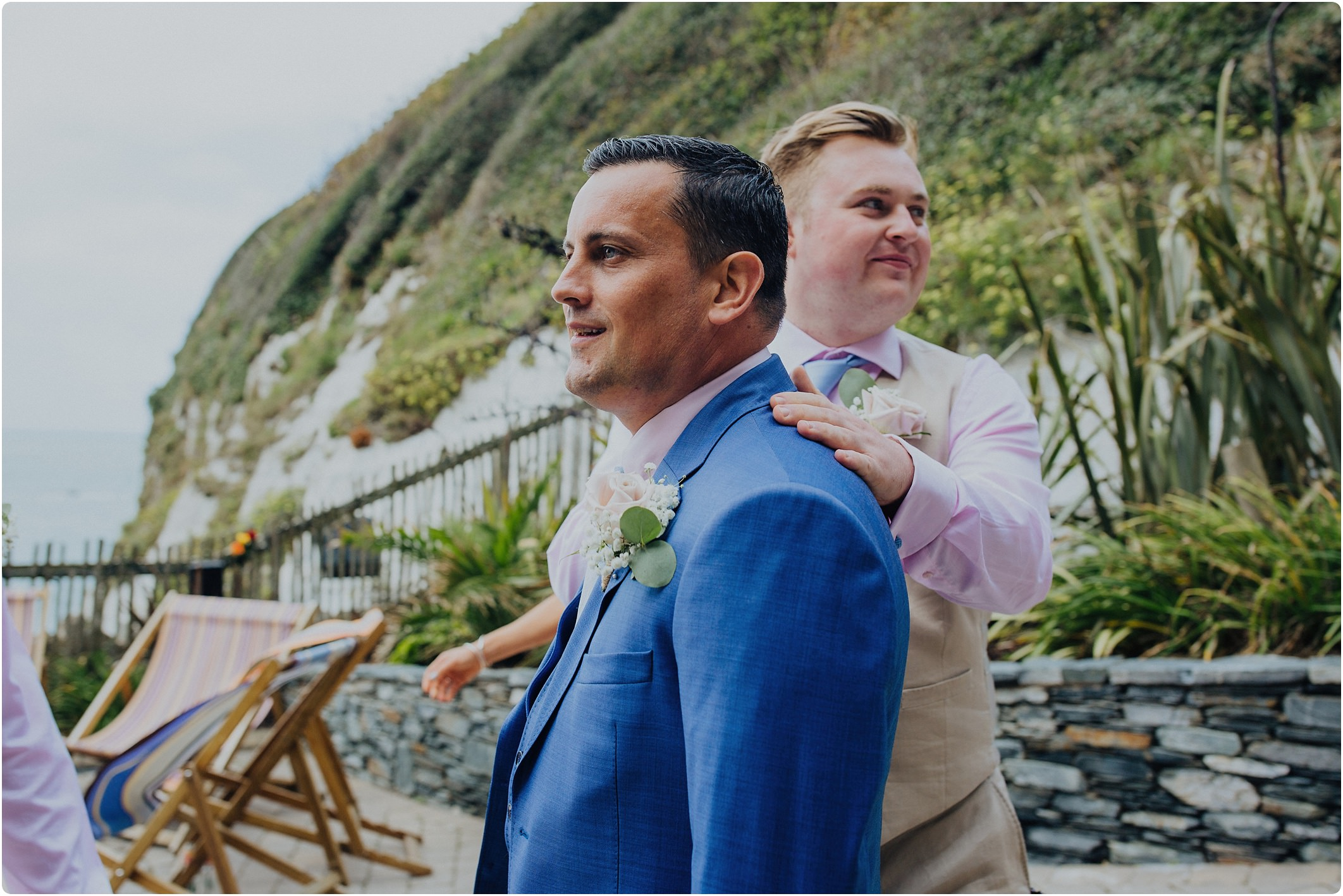 groom in a blue ted baker suit looking nervous at a tunnels beach wedding