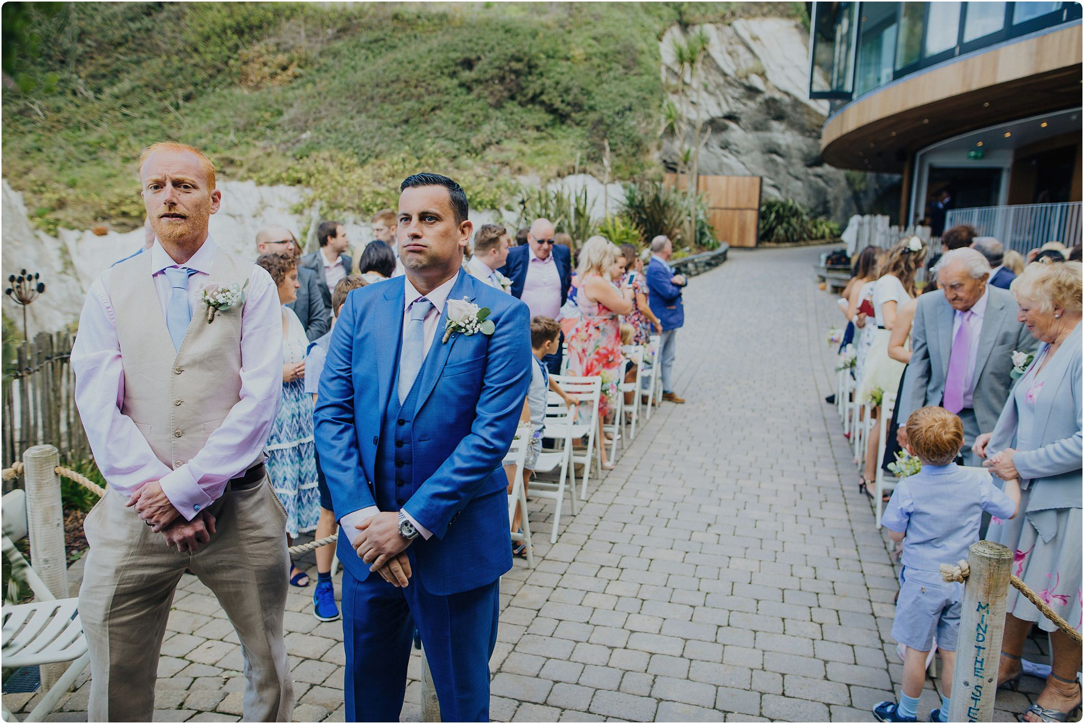 nervous groom in blue ted baker suit at a tunnels beach wedding