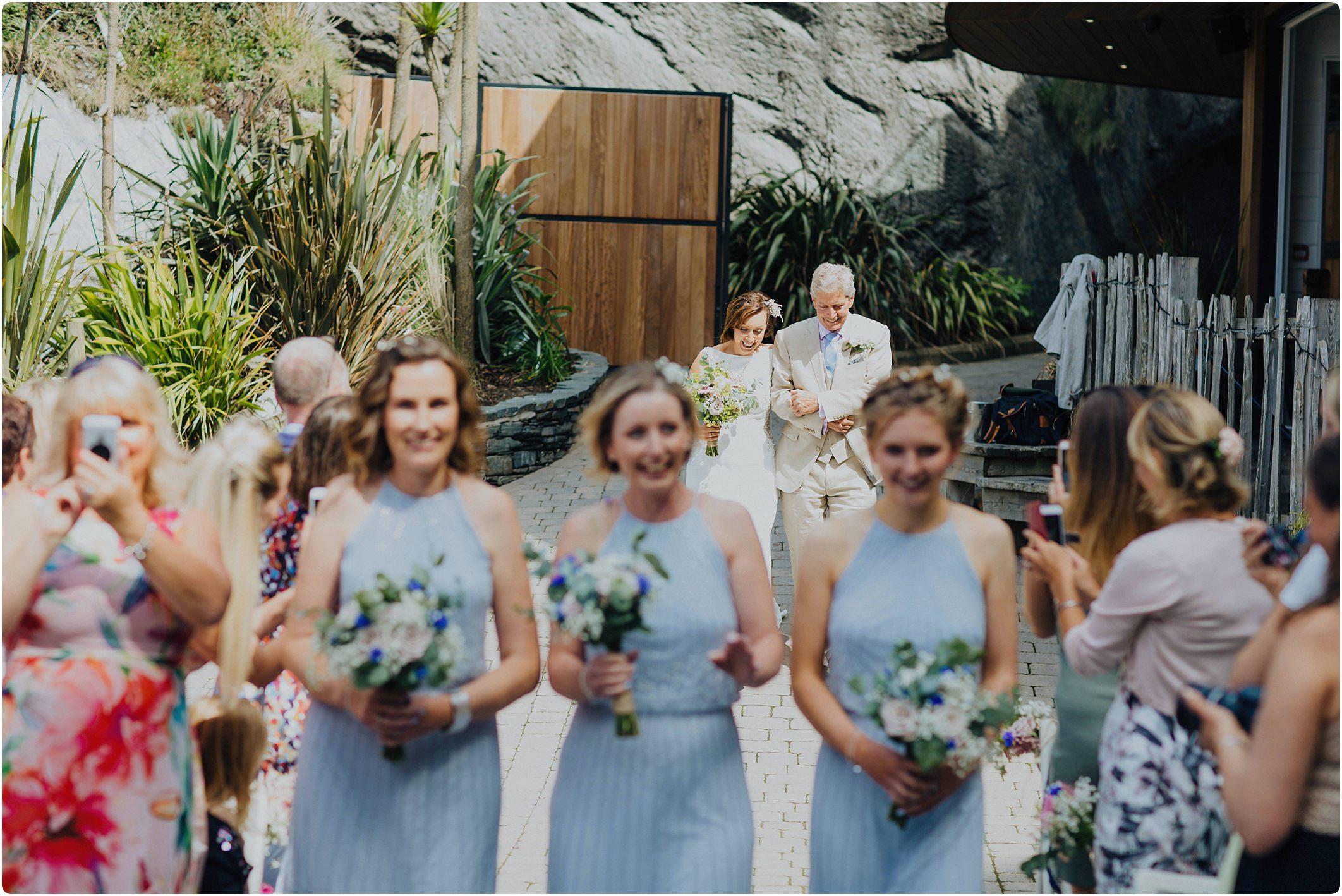 bride walking down aisle at a tunnels beach wedding