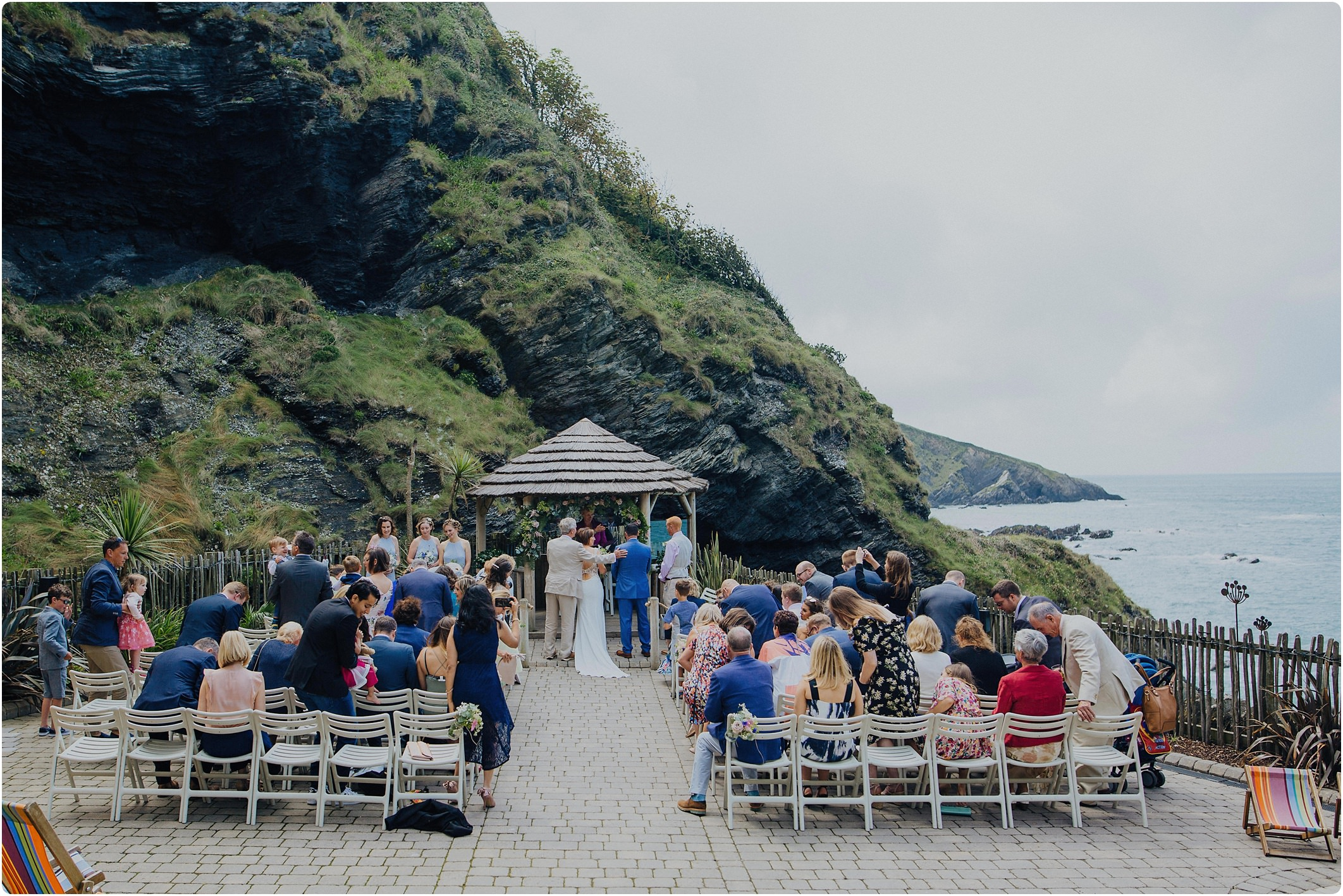 groom shaking father of brides hand at a tunnels beach wedding
