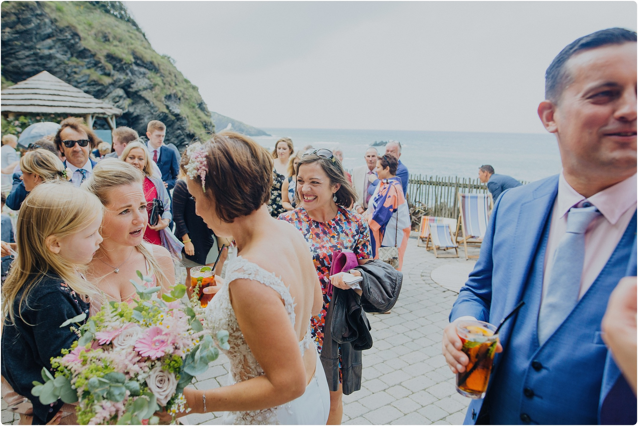 chatting to guests after a tunnels beach wedding