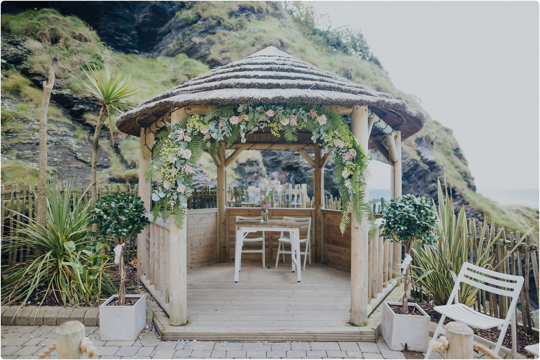 pagoda dressed with flowers by off shore blooms at a tunnels beach wedding