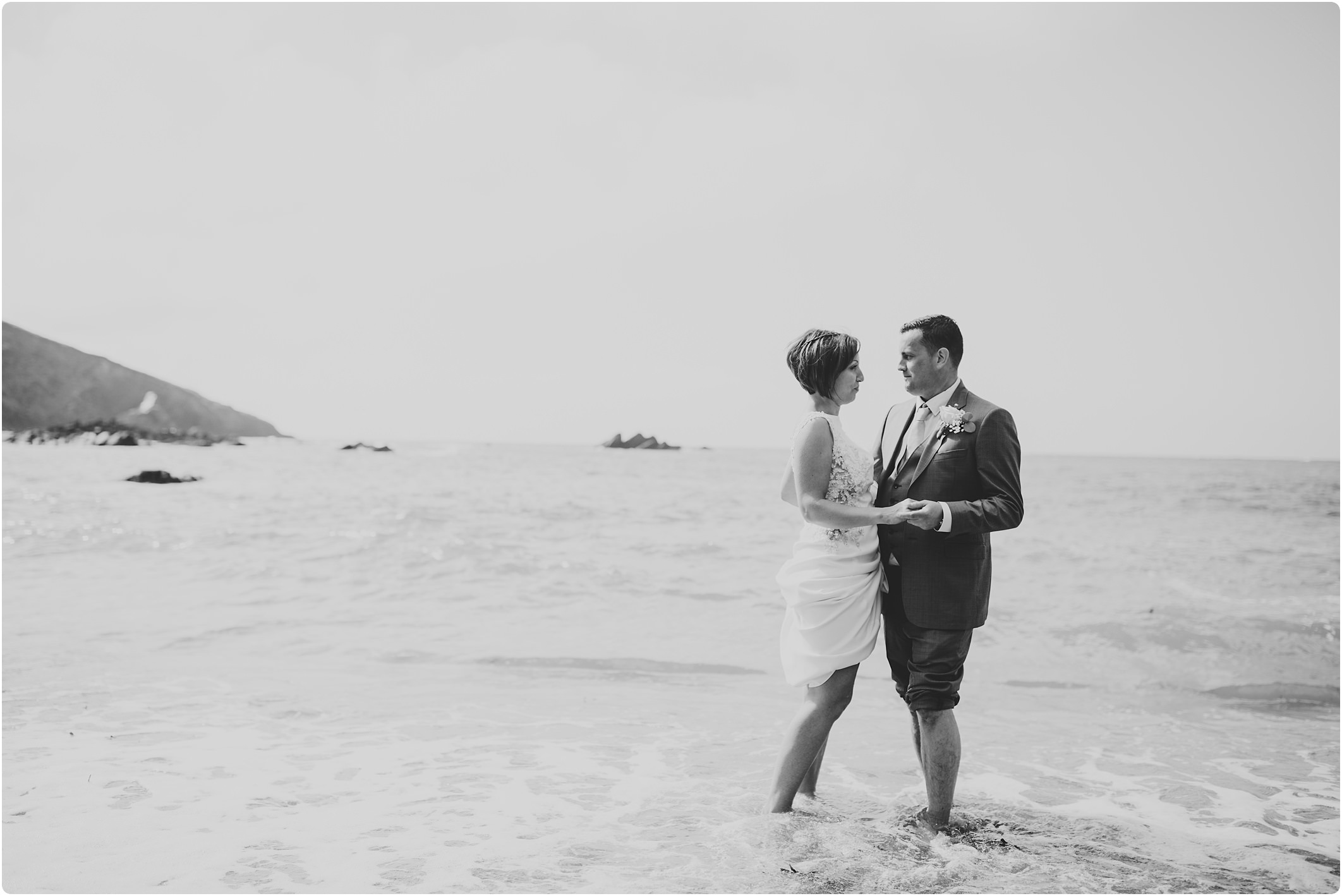 black and white of couple at a tunnels beach wedding