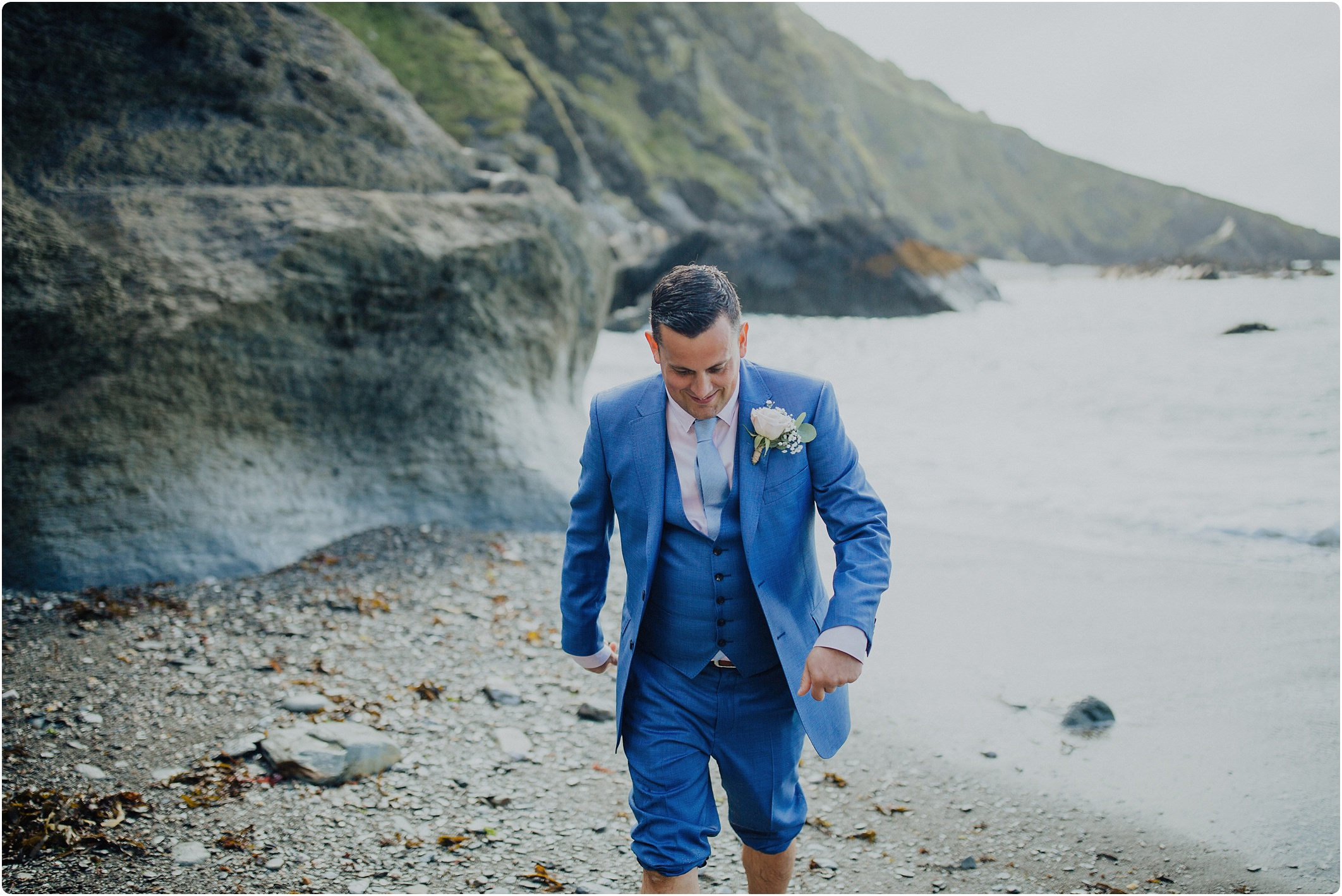 beach groom in a blue ted baker suit at a tunnels beach wedding