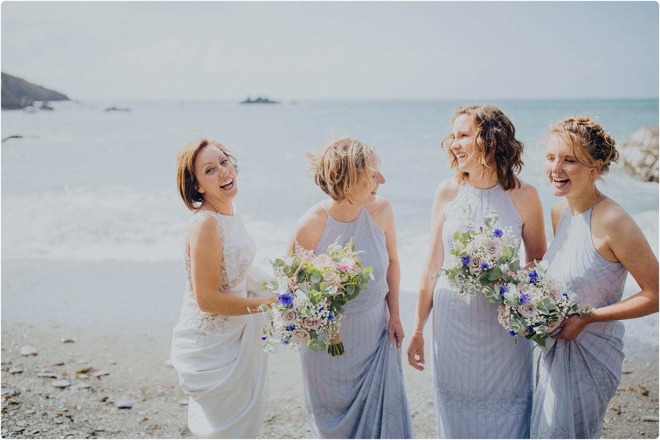 bride and bridesmaid on beach at a tunnels beach wedding