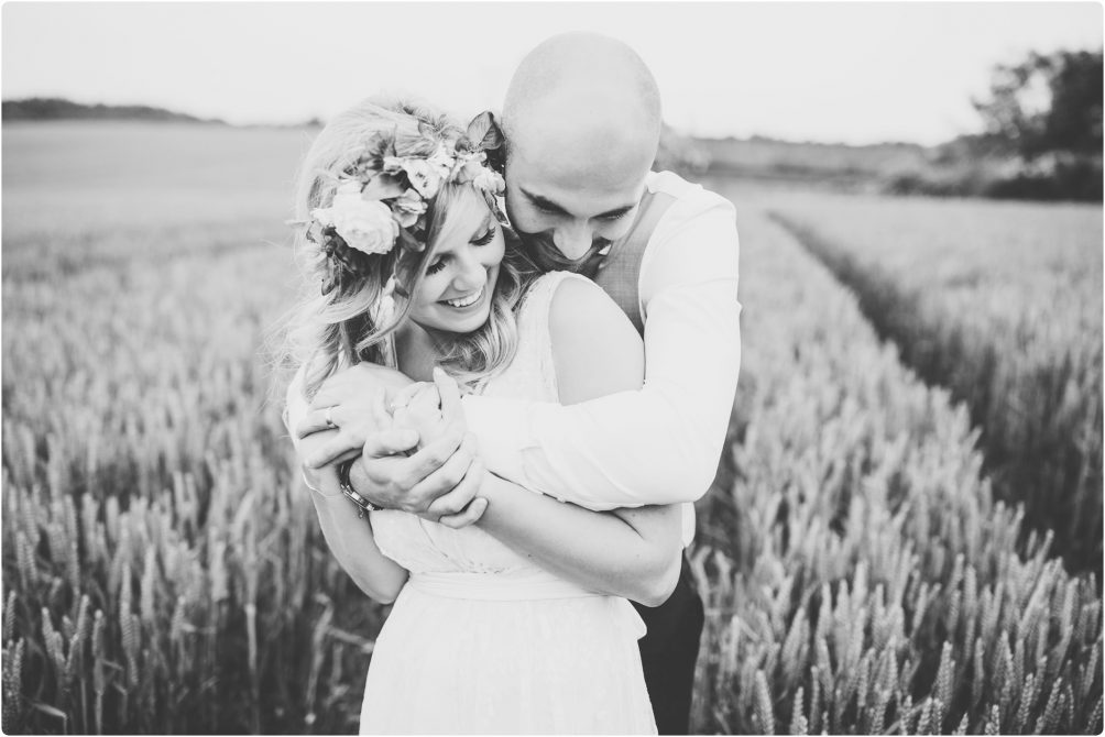 bride and groom in field at cripps Barn Gloucestershire