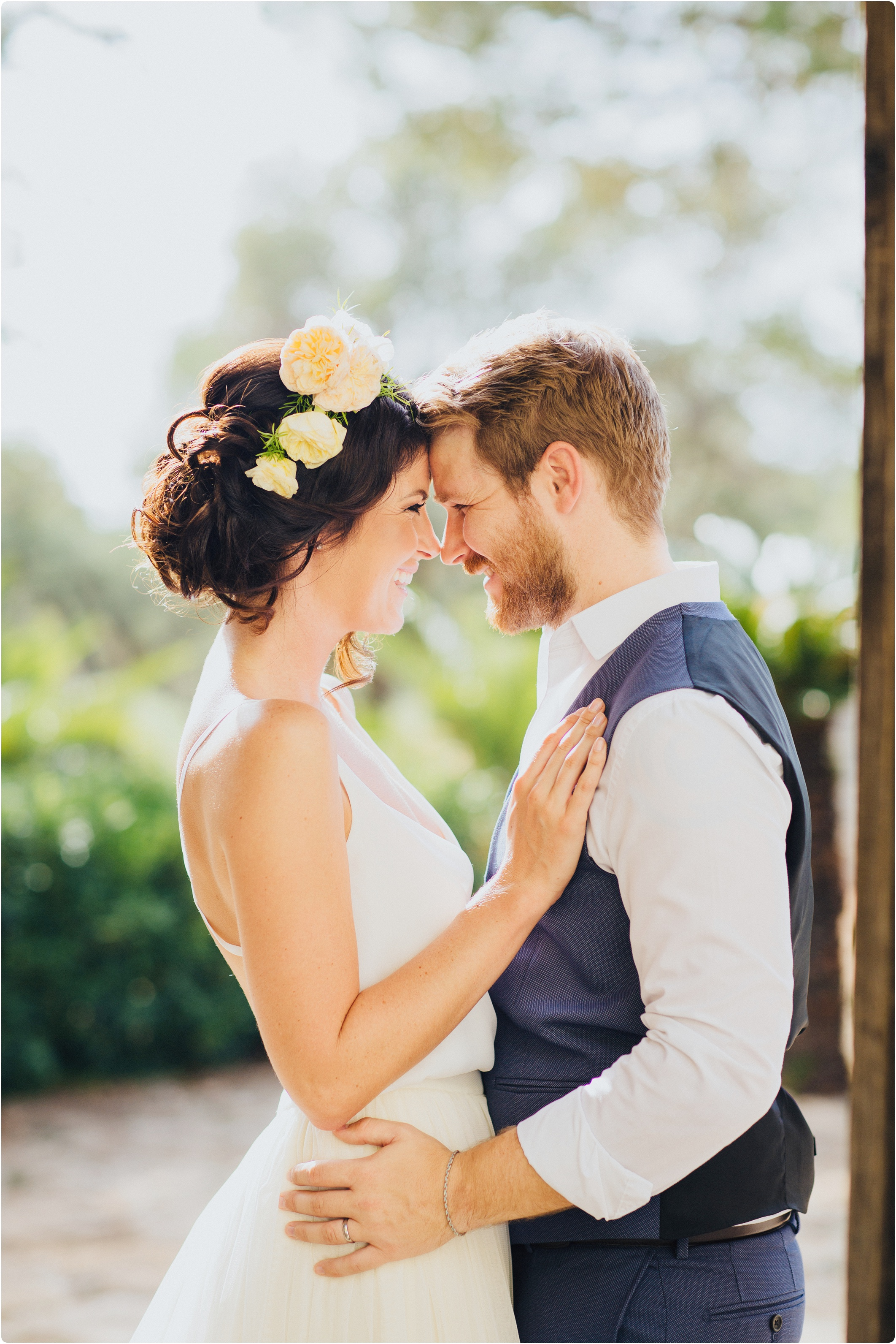 bride and groom in olive grove in south italy