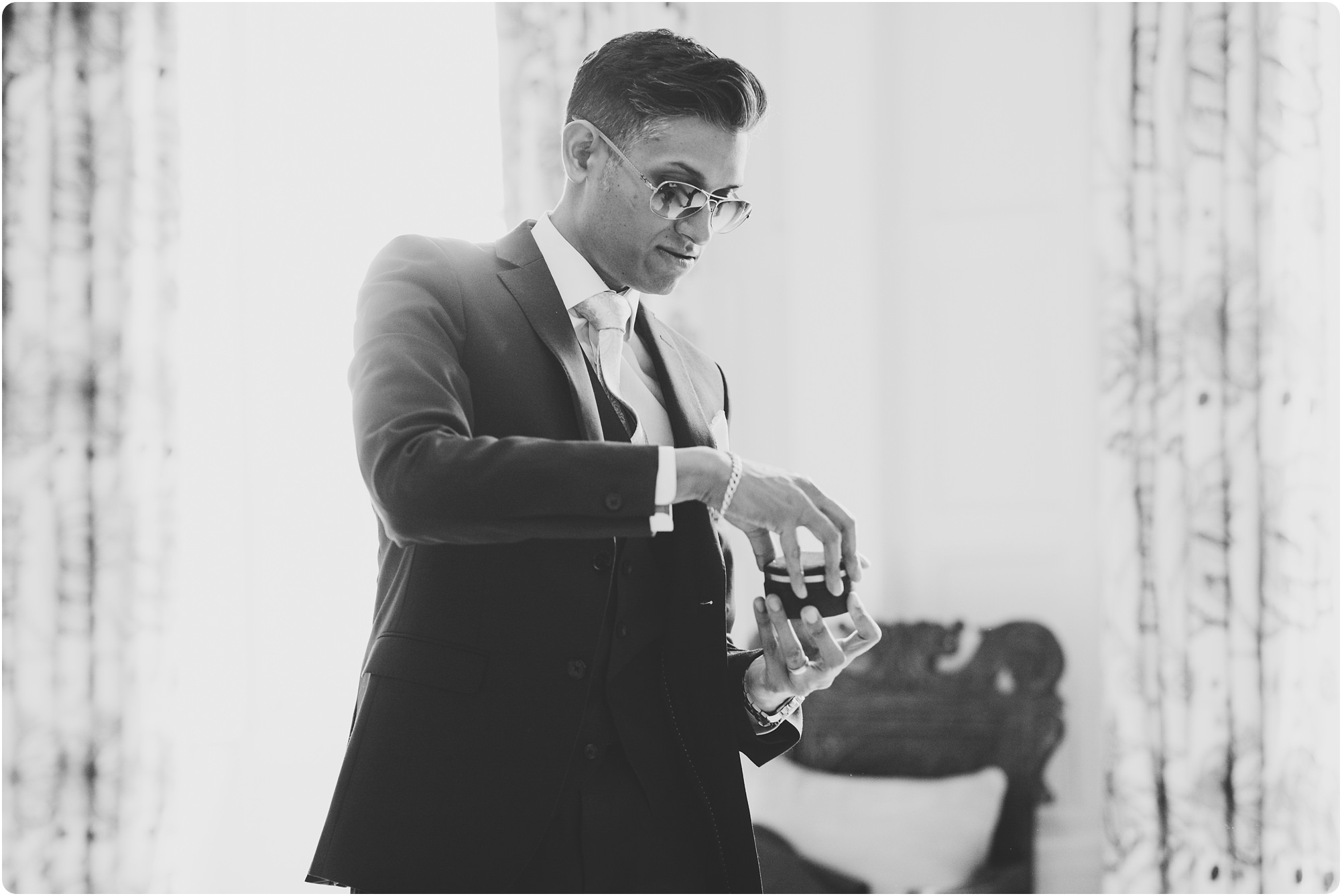 groomsmen getting ready with sunglasses on at an Elmore Court Indian Wedding