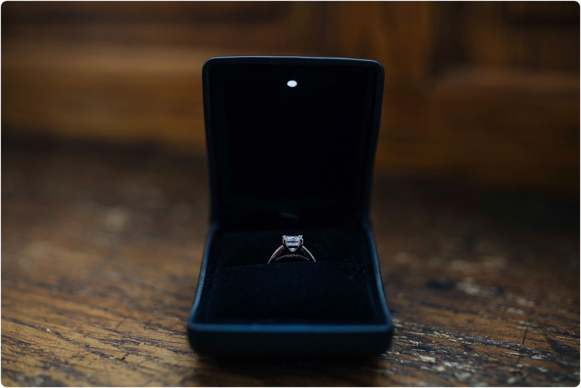engagement ring in box with a light at an Elmore Court Indian Wedding