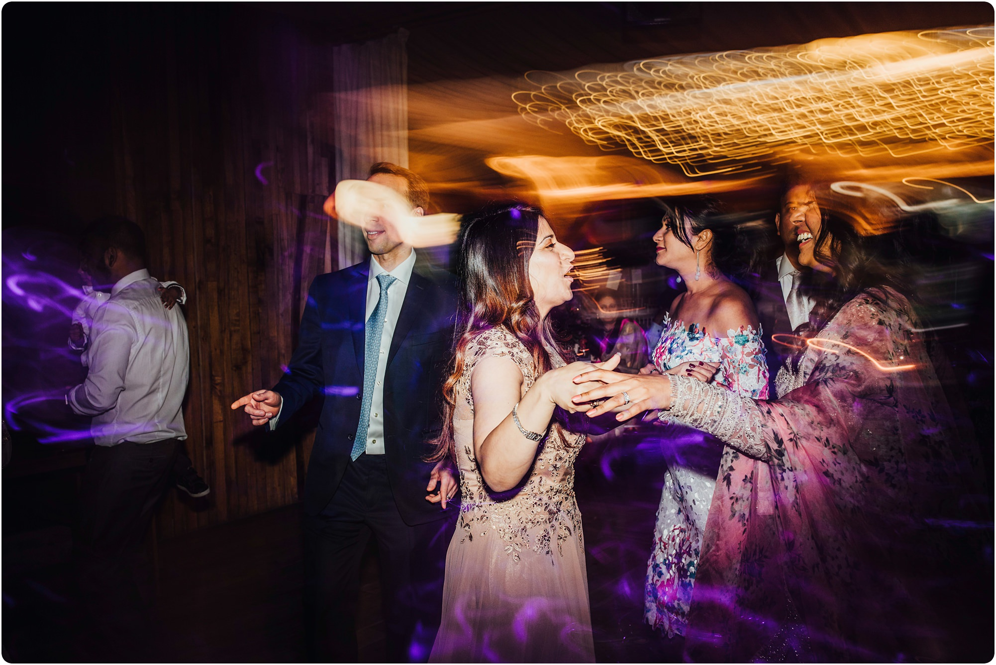 guests talking to bride at an Elmore Court Indian Wedding