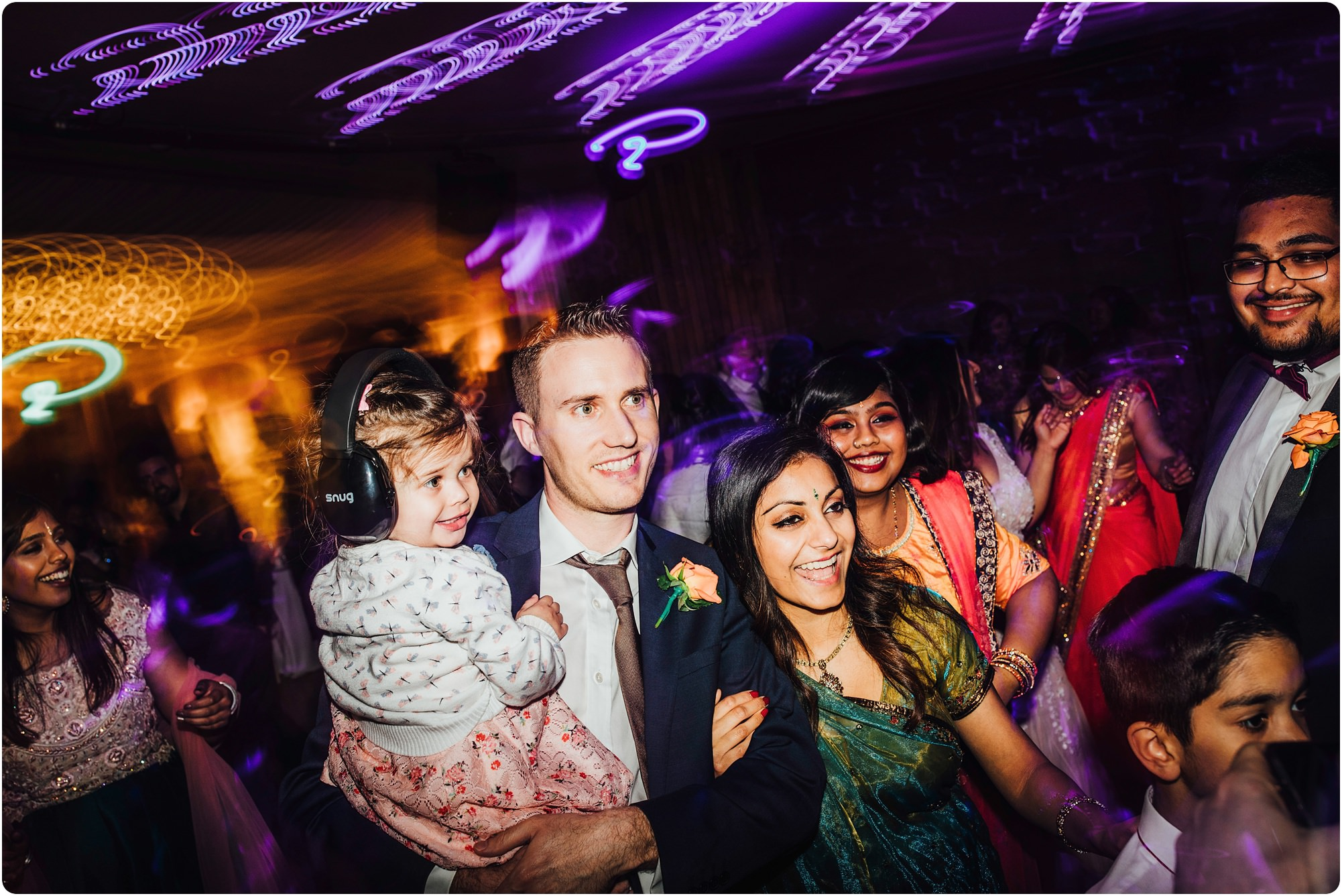 little girl with kid headphones on at an Elmore Court Wedding