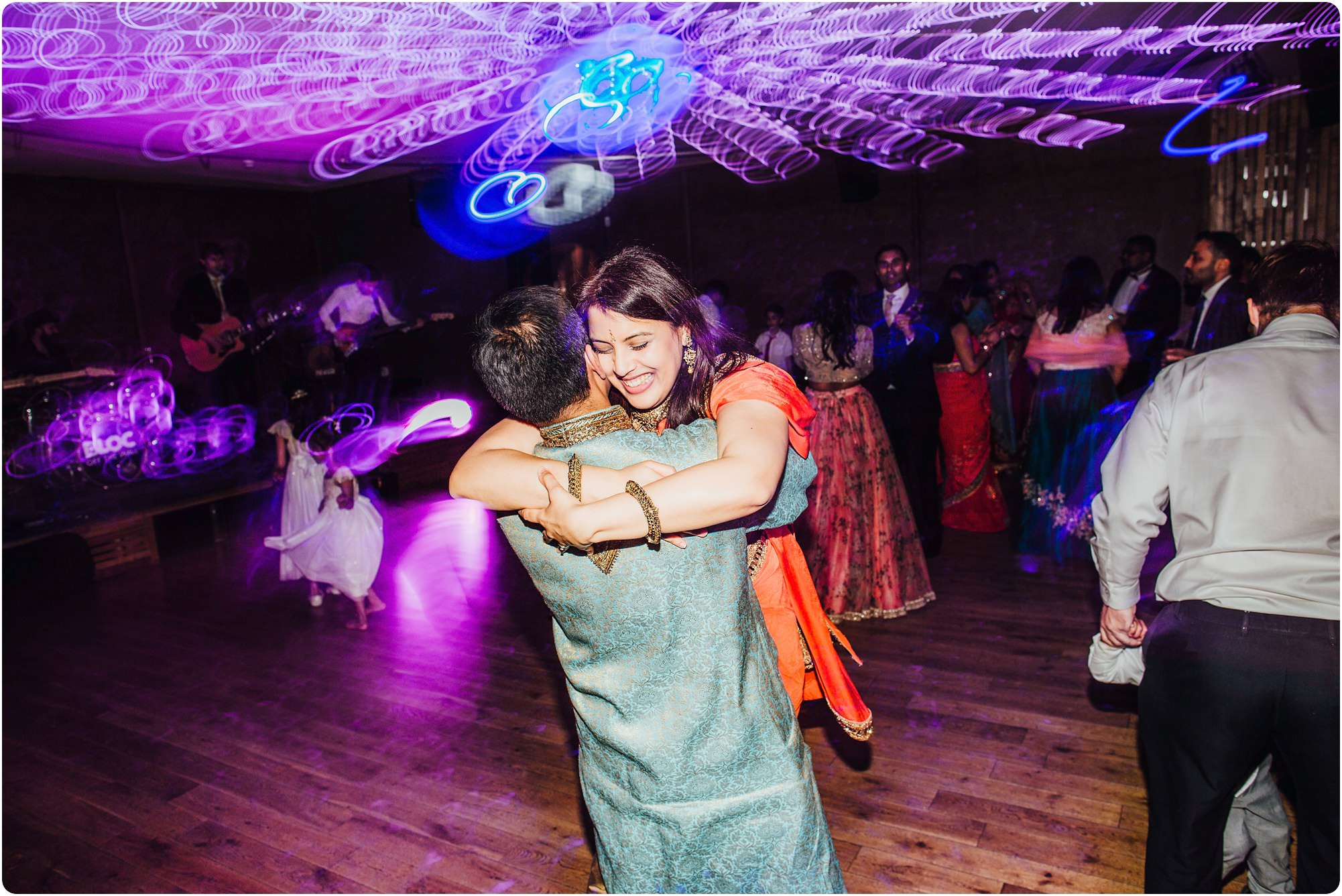 couple hugging on dance floor at an Elmore Court Wedding
