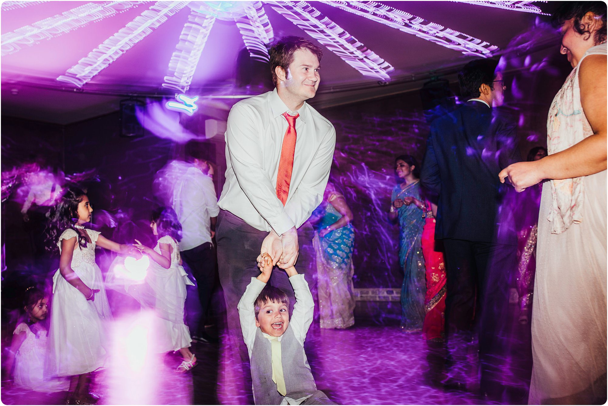 man and child on the dance floor at an Elmore Court Wedding