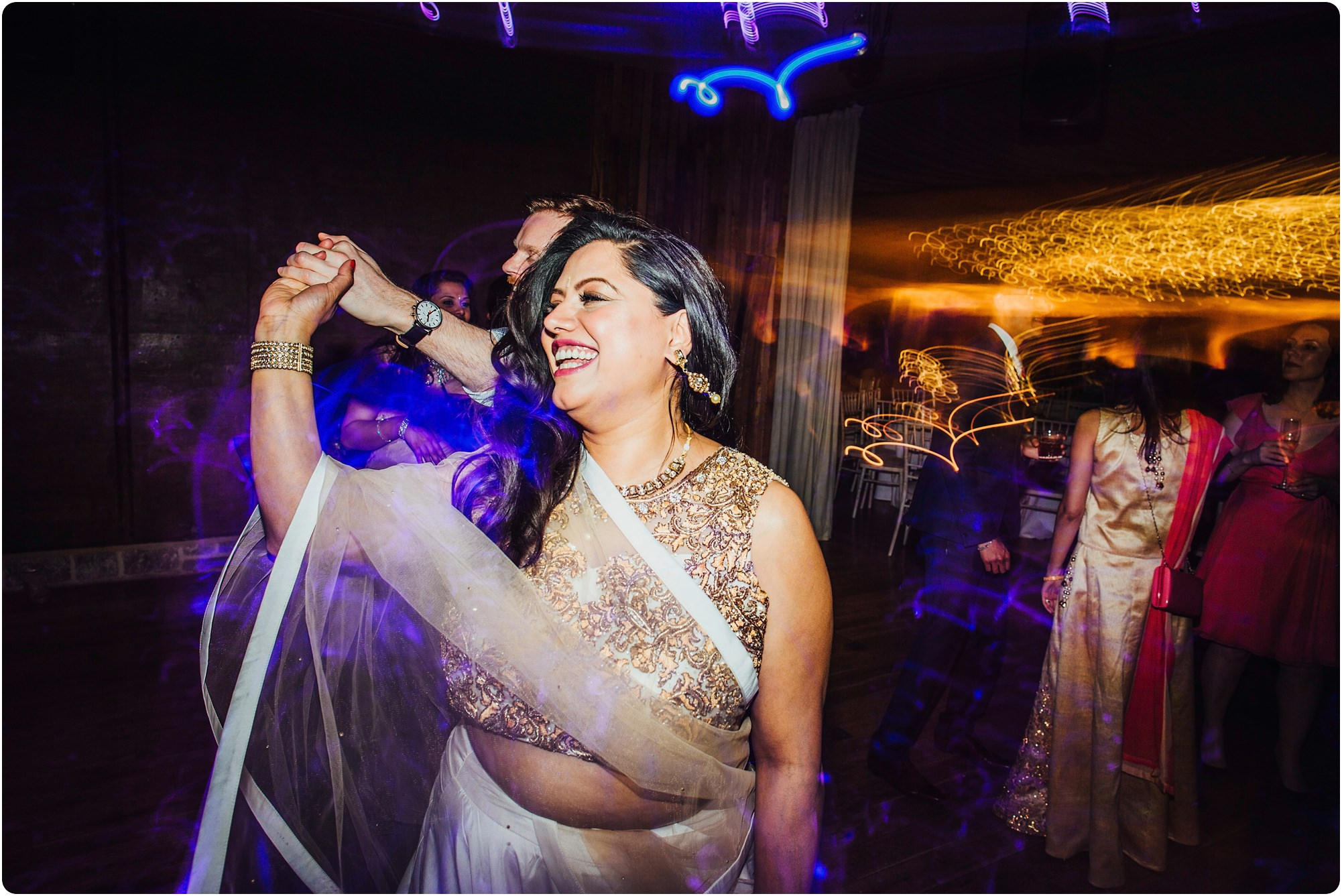 beautiful Indian dress and dancing at a an Elmore Court Wedding]]