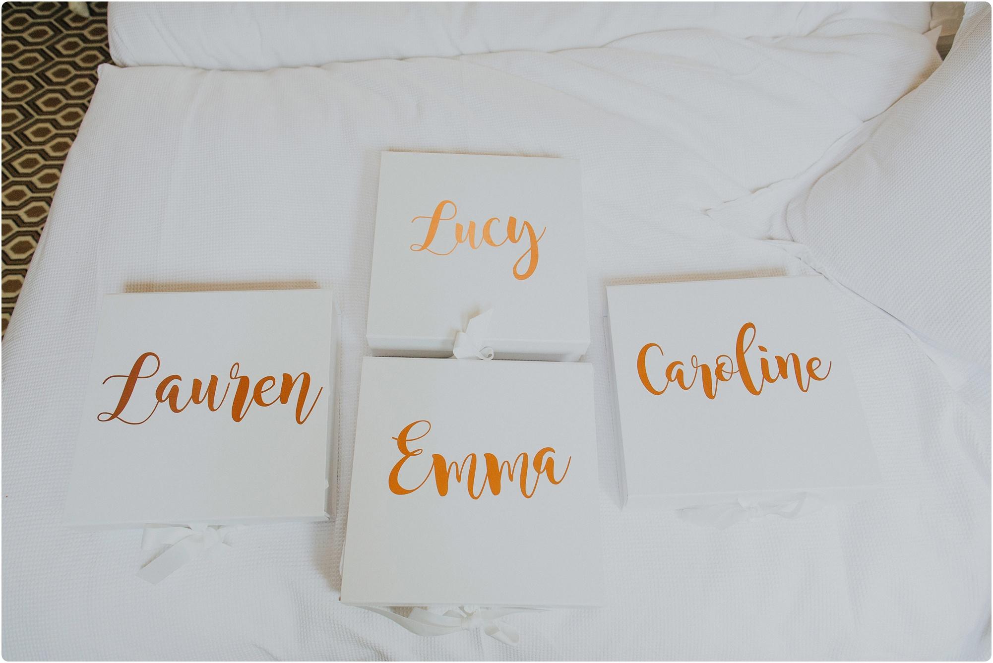bridesmaid gift boxes with gold writing at Barnsley House