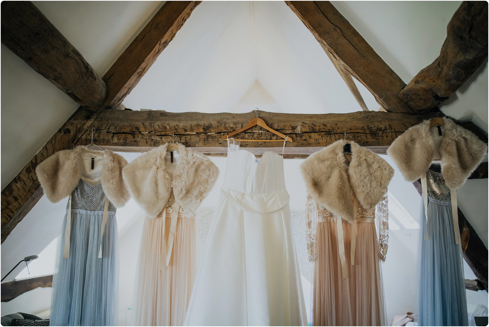 needle and thread bridesmaid dresses hanging up at Barnsley House Wedding