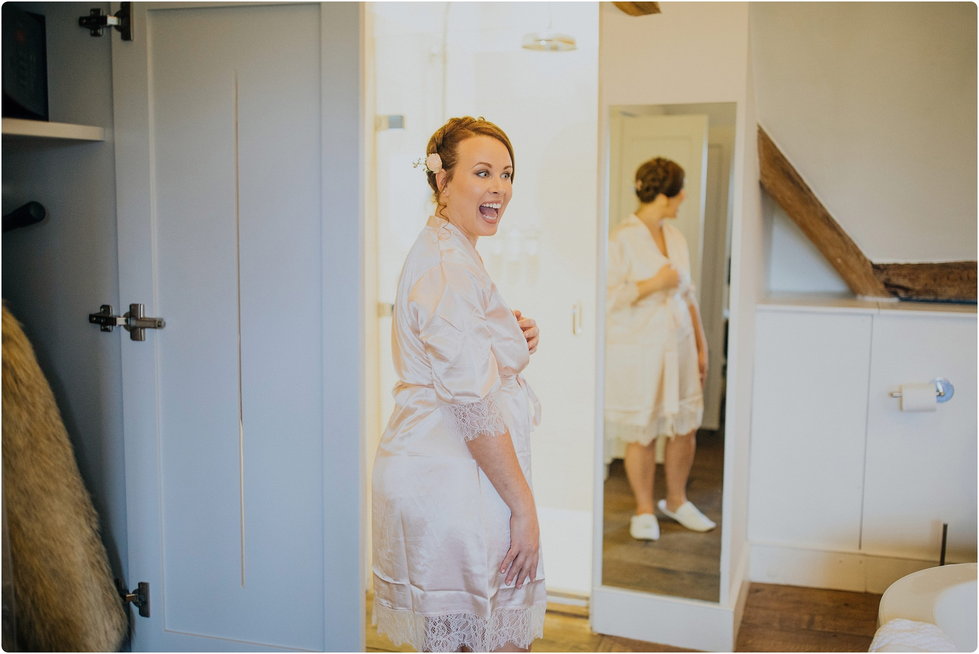 bridesmaid in peach robe at a Barnsley house wedding