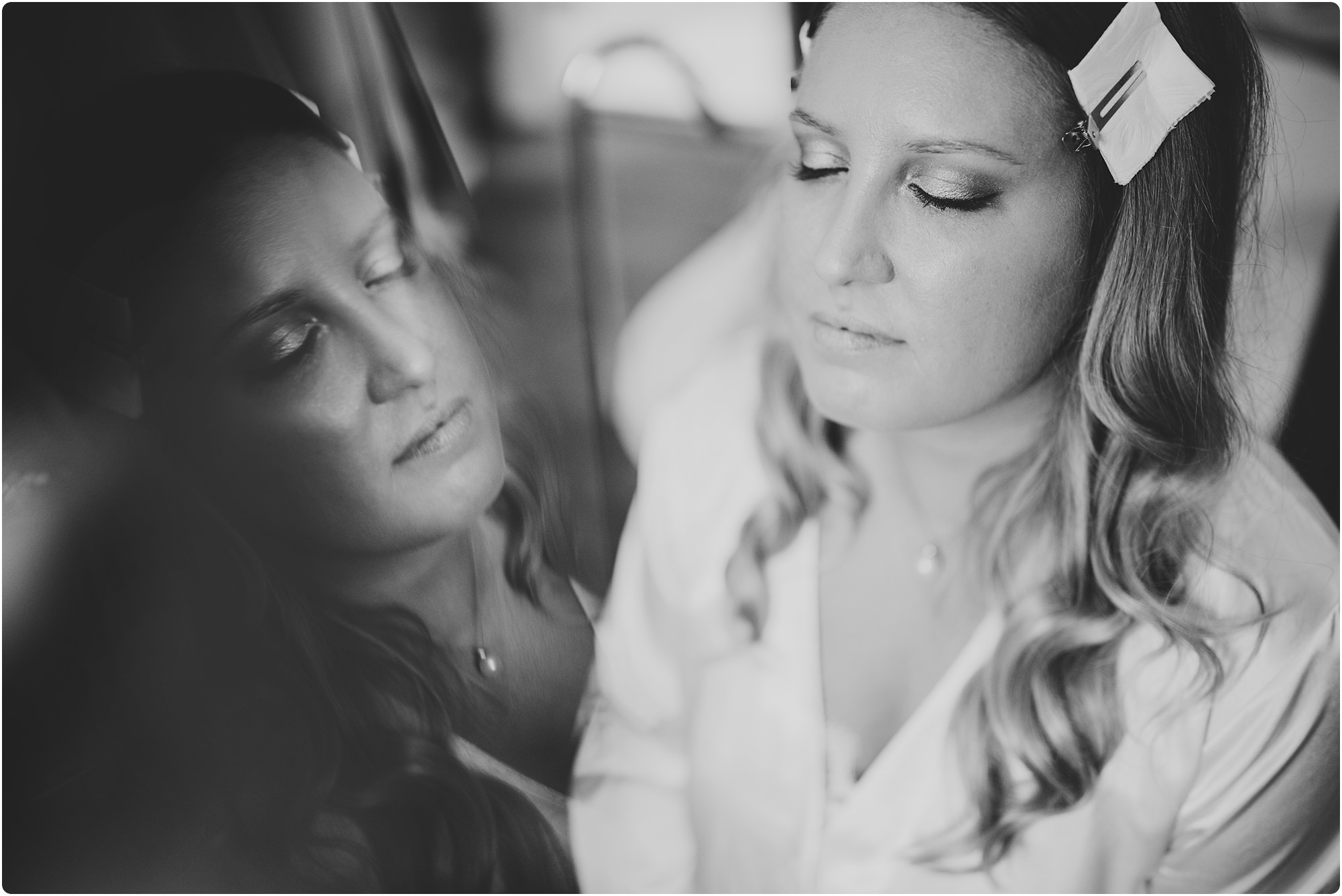 bride getting make up done with a reflection at a Barnsley House Wedding