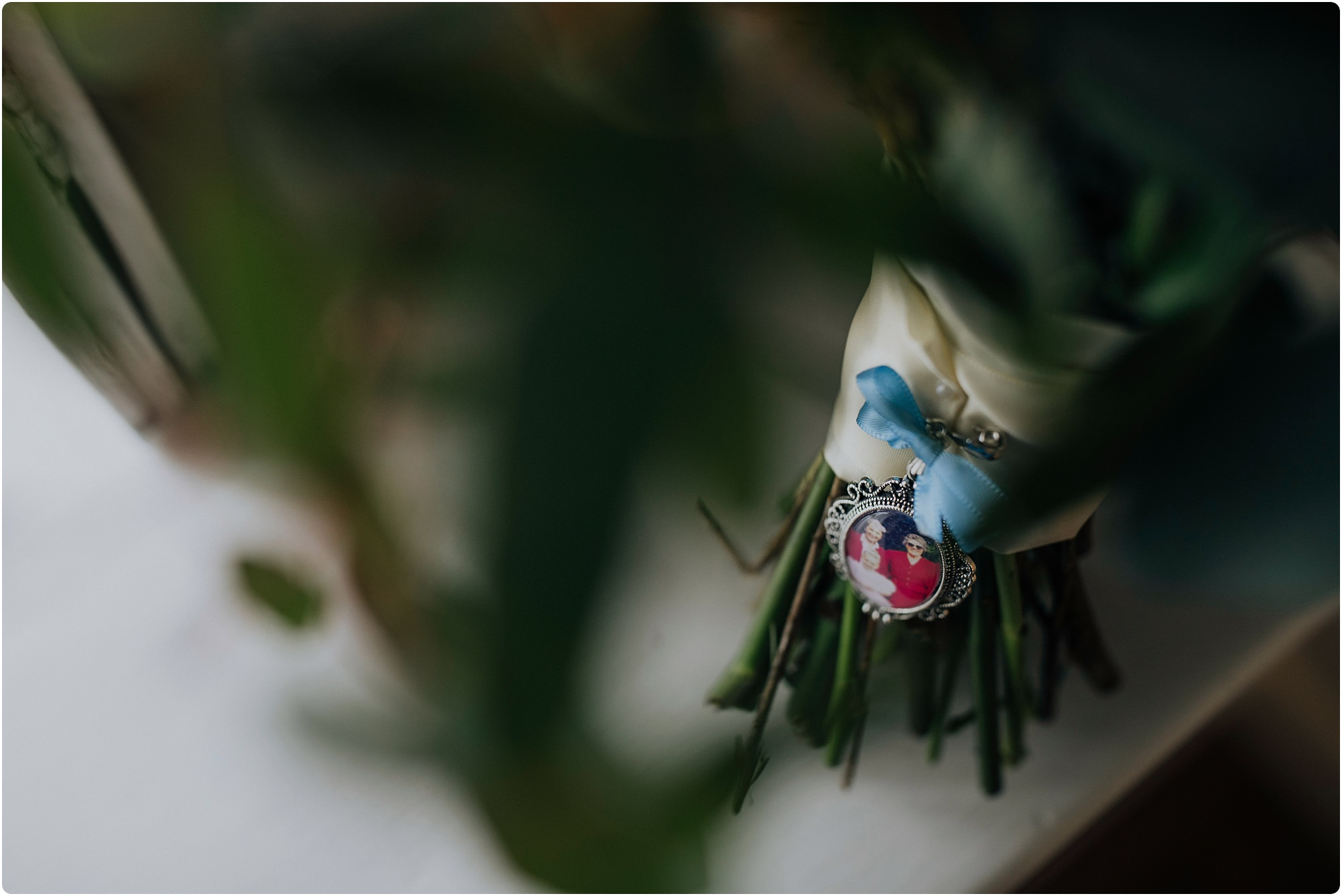 brooch of brides grandmothers on her bouquet by go wild flowers