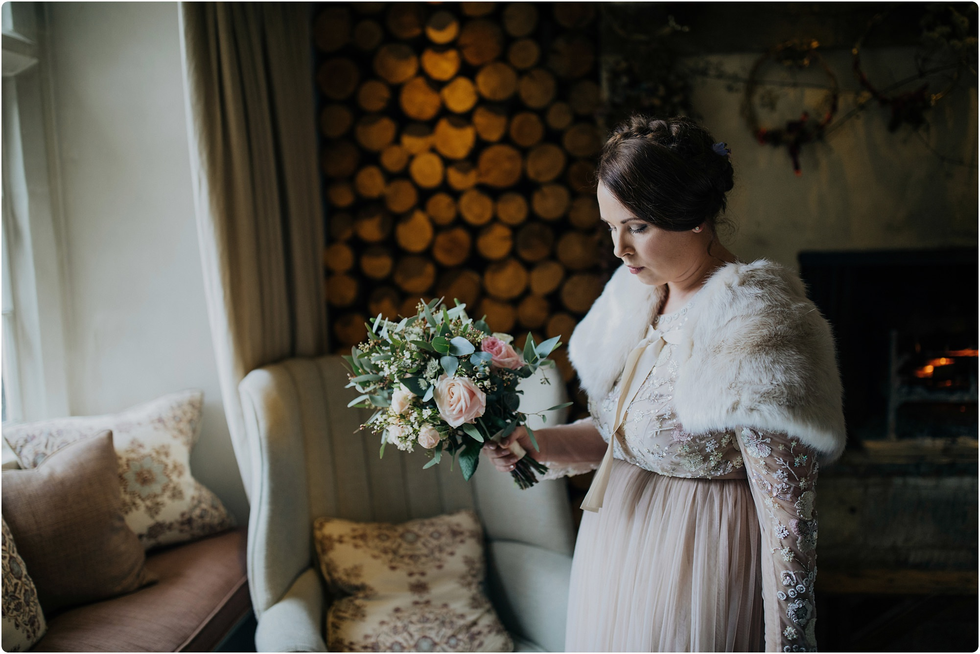 Bridesmaid wearing a long sleeved embroidered needle and thread dress at a Barnsley House wedding