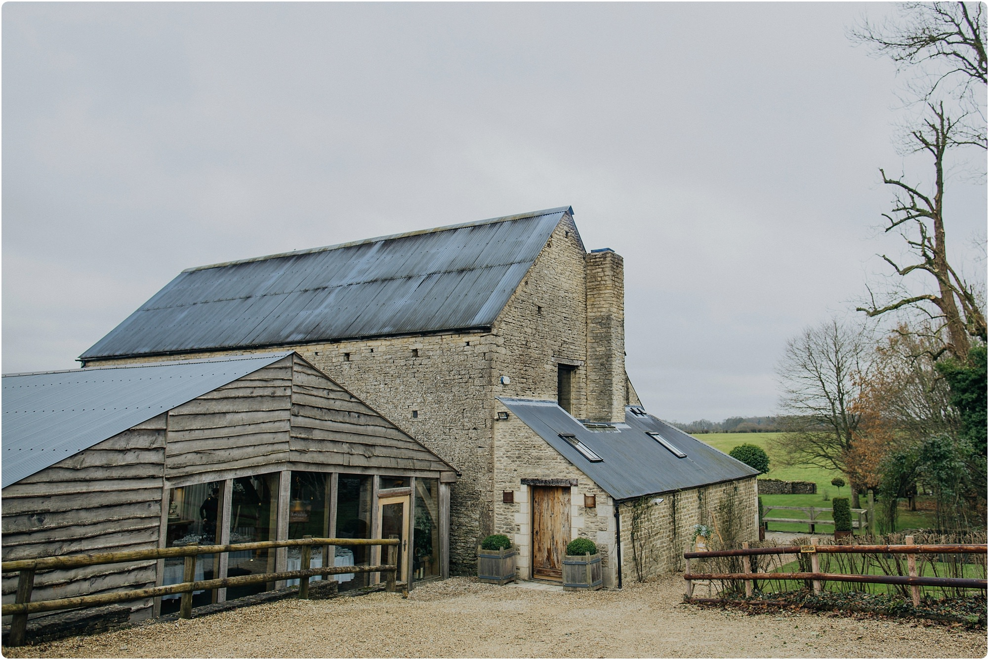 the outside of Cripps Barn at a winter wedding