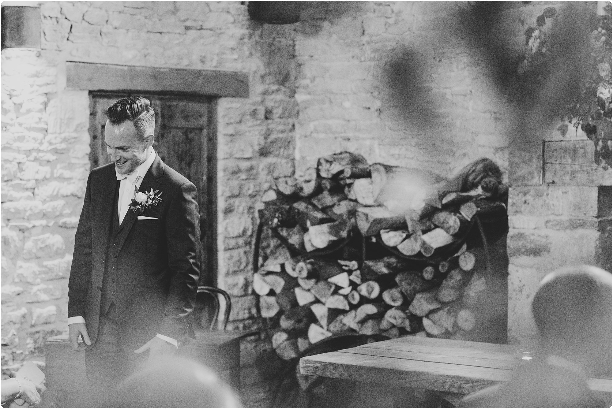 groom wearing a ted baker suit at a Cripps Barn Winter Wedding