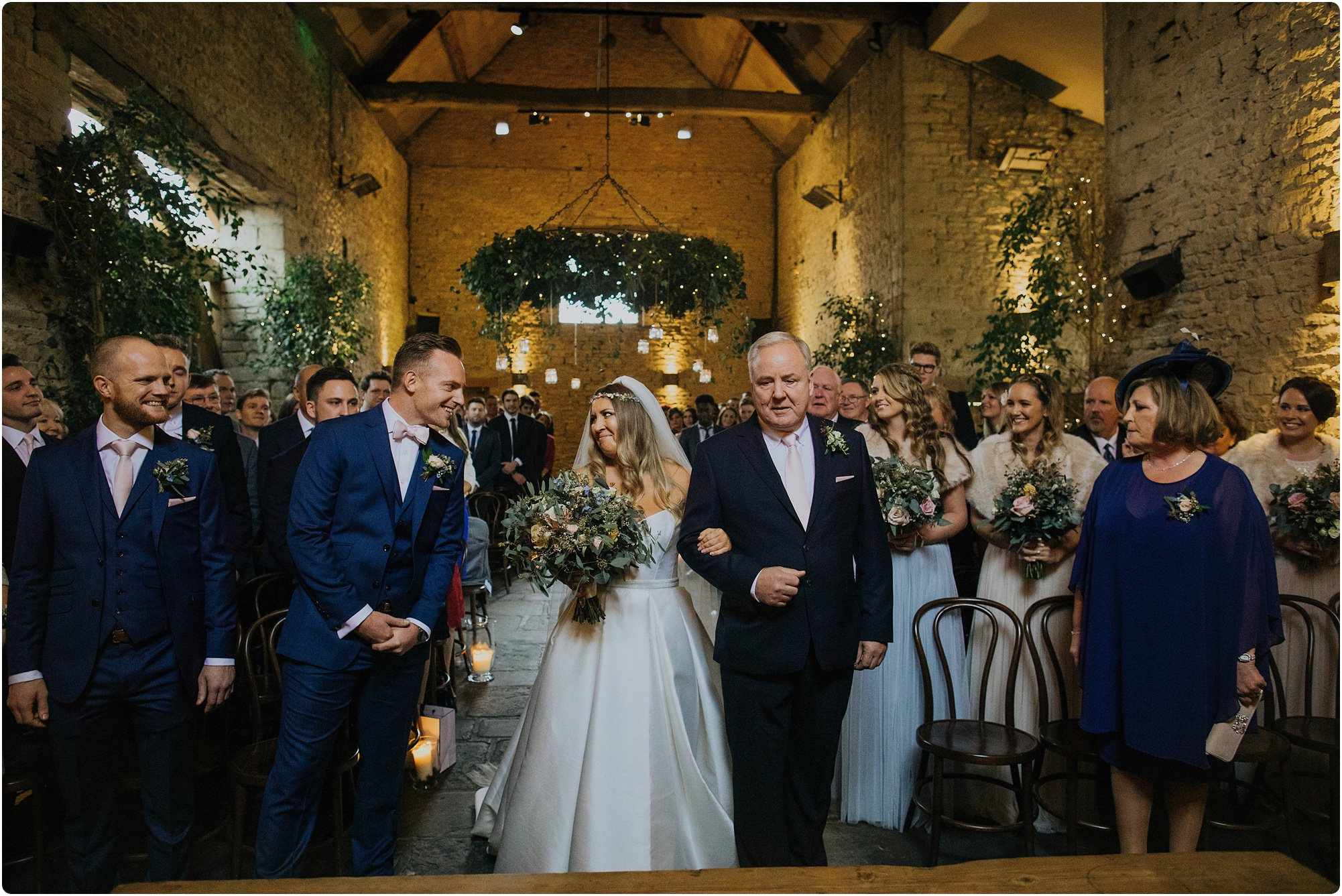 bride and groom seeing each other for first time at a Cripps Barn Winter Wedding