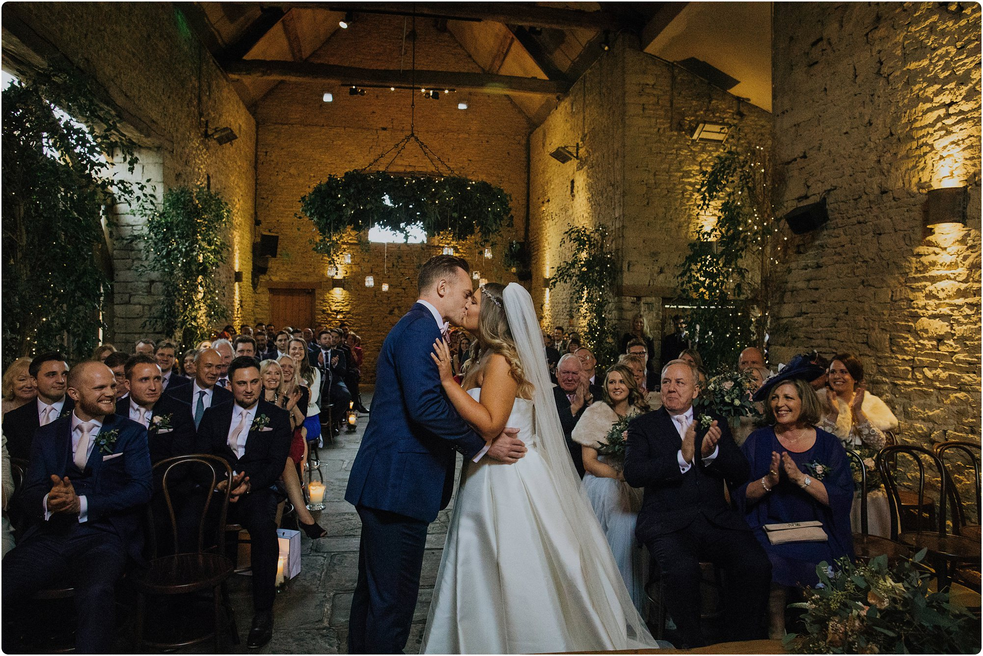 first kiss at a Cripps Barn Winter Wedding