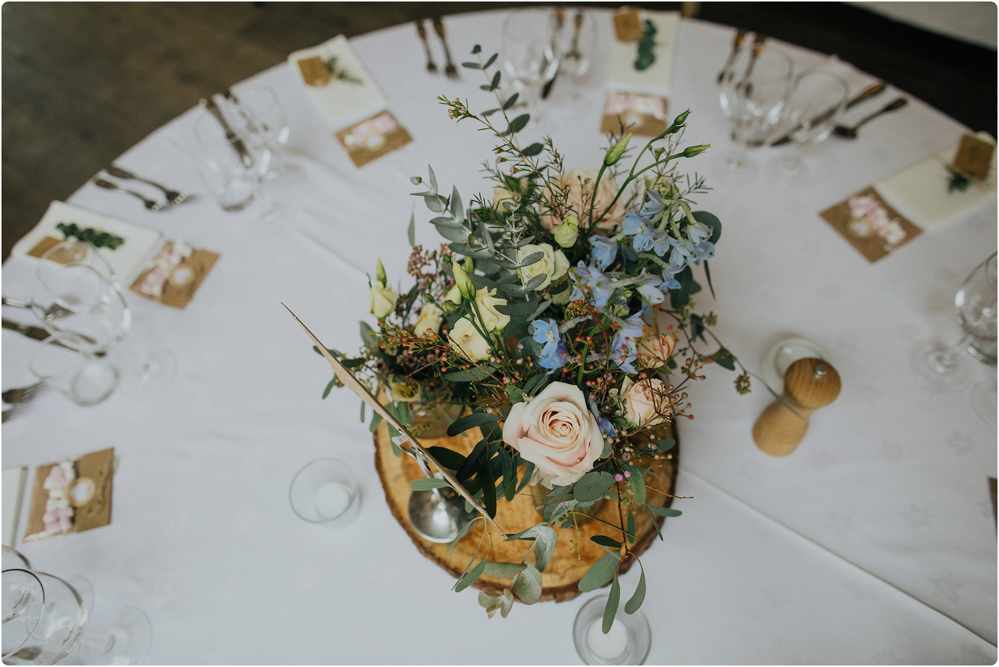 centre piece of flowers at a Cripps Barn Winter Wedding made by Go Wild Flowers