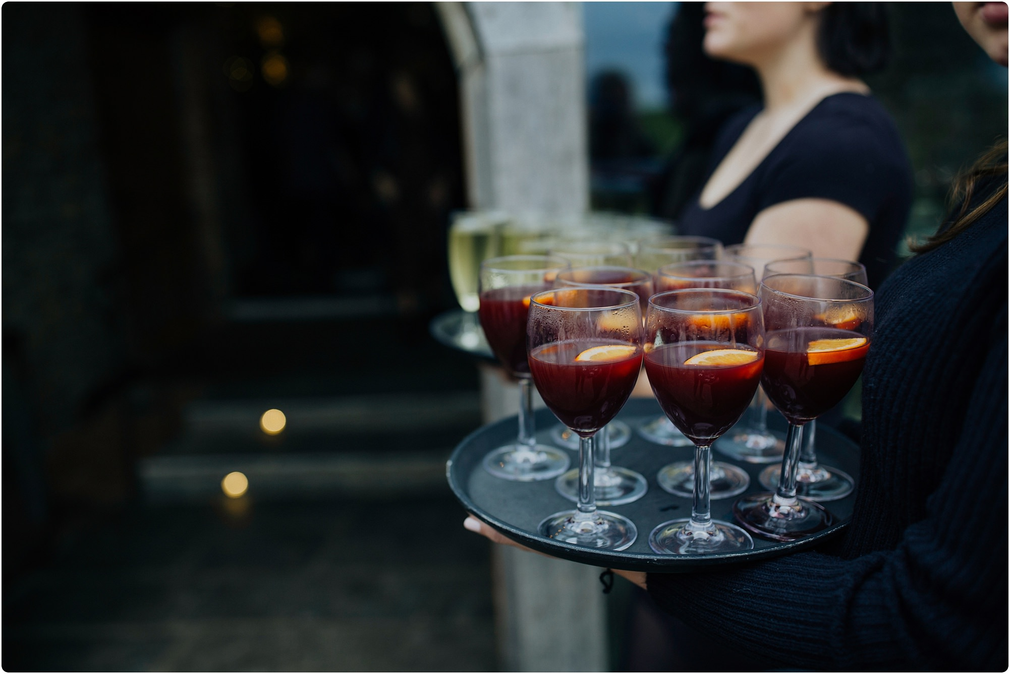 mulled wine being served outside for a Cripps Barn Winter Wedding