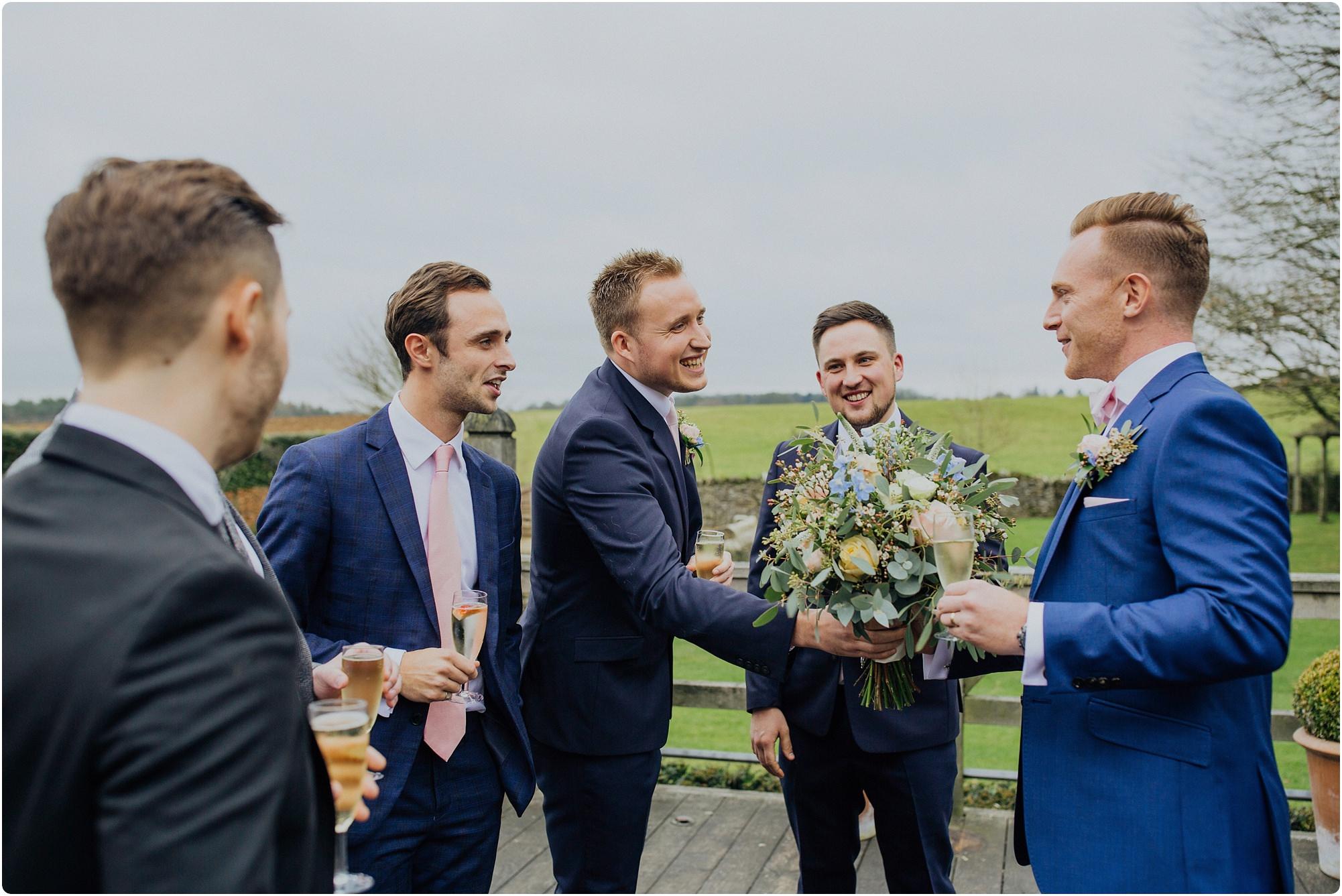 friends congratulating the groom at a Cripps Barn Winter Wedding