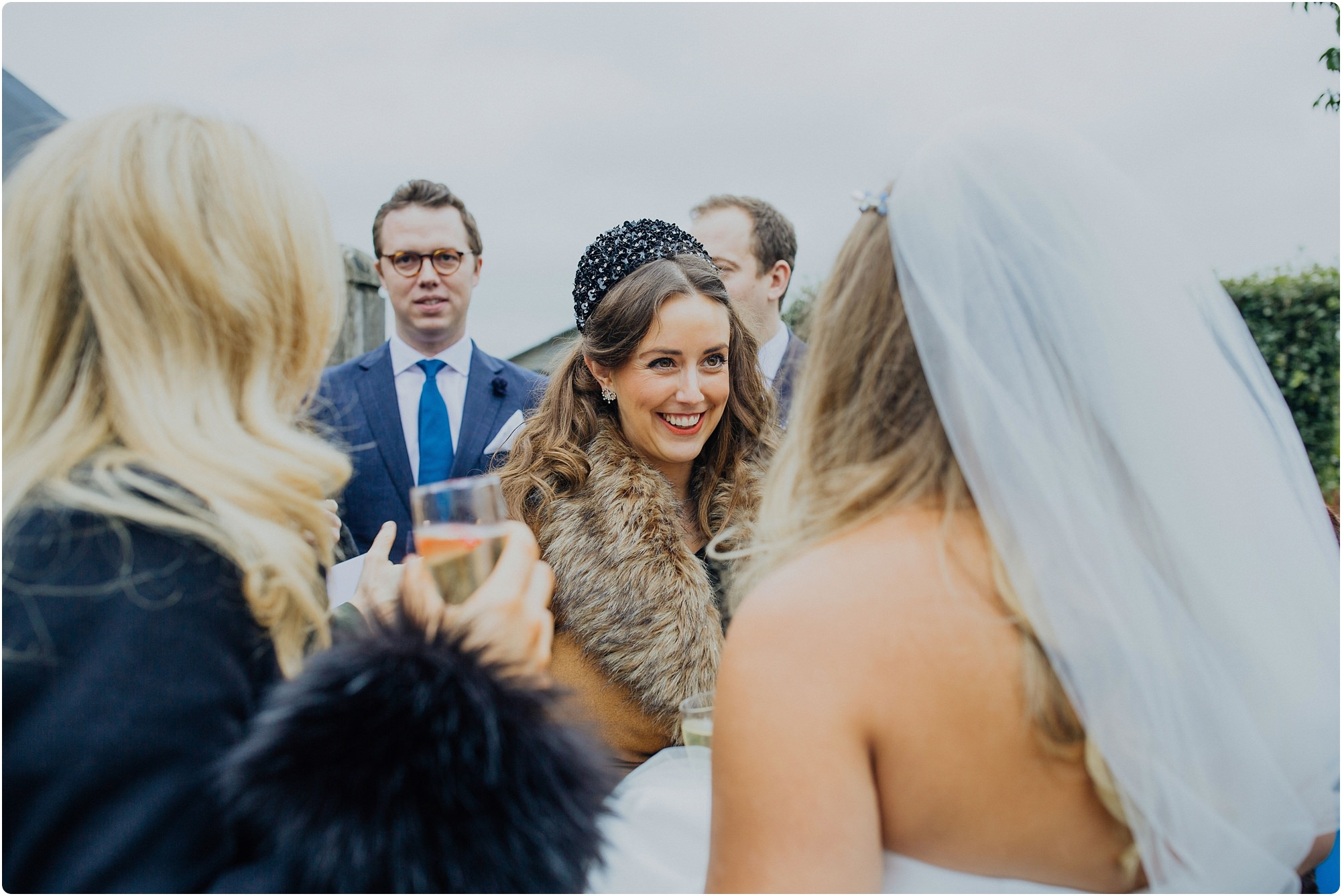 friends congratulating the bride at a Cripps Barn Winter Wedding