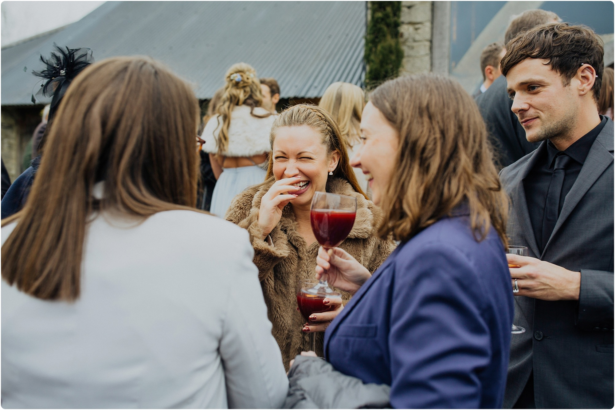 friends congratulating the bride at a Cripps Barn Winter Wedding