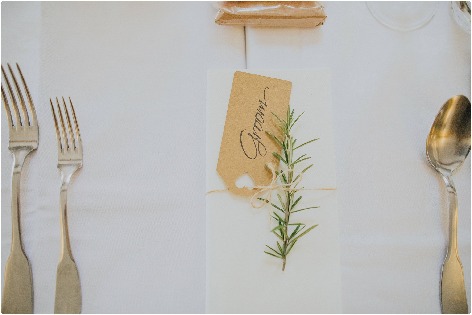 luggage tag name place and rosemary for rustic decor at a Cripps Barn Winter Wedding