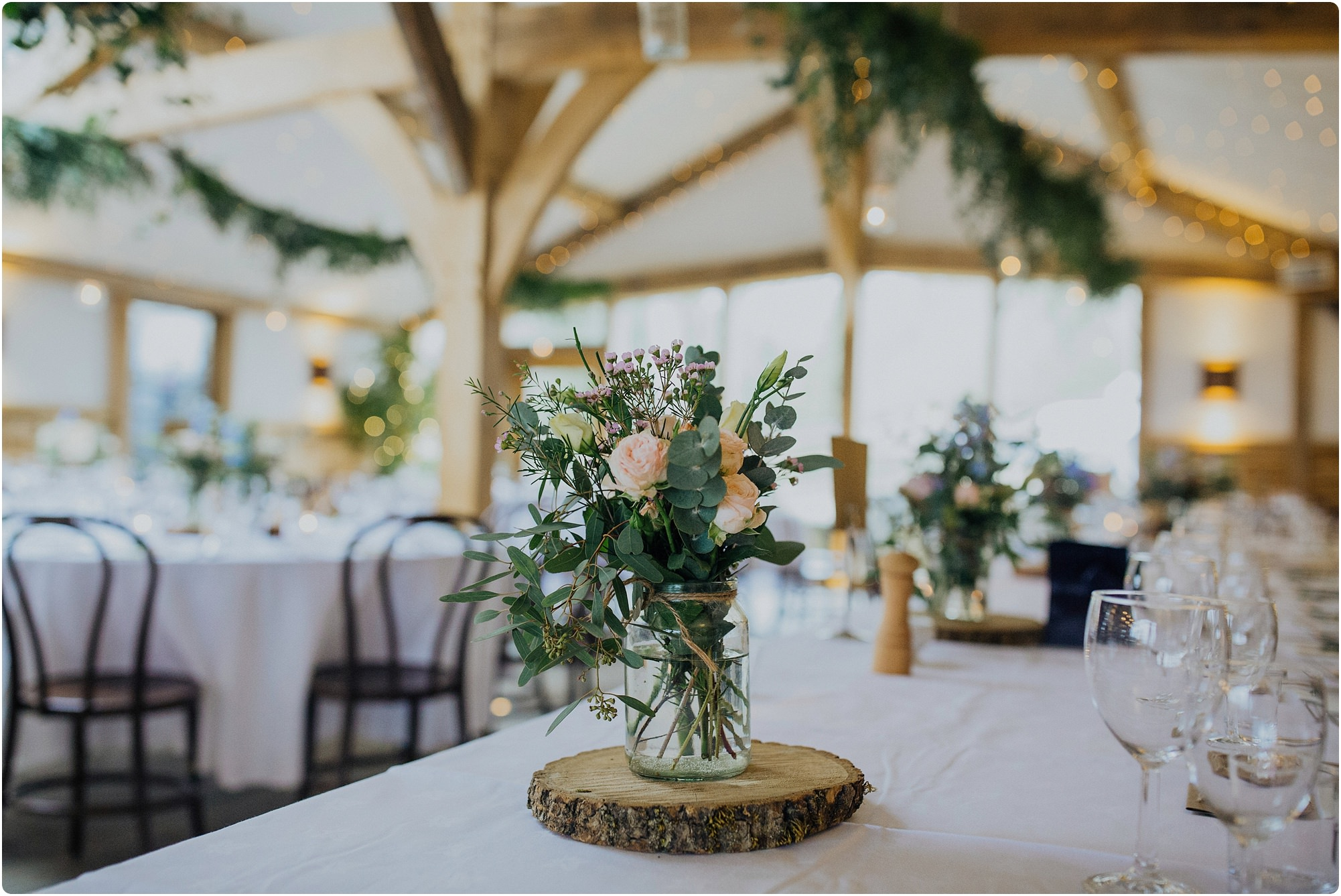 centre piece flowers by Go Wild Flowers at a Cripps Barn Winter Wedding