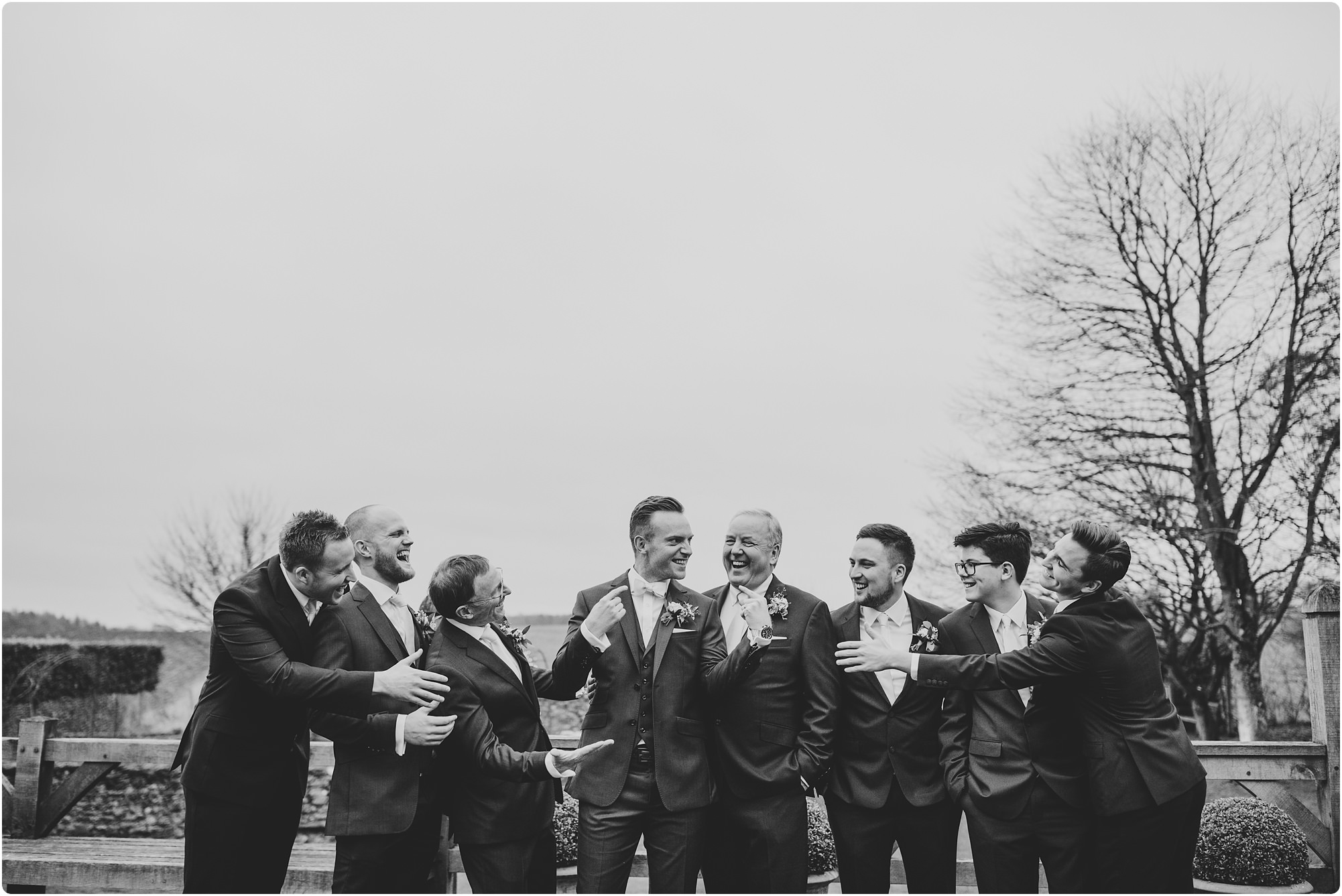 line up of the groomsmen at a Cripps Barn Winter Wedding