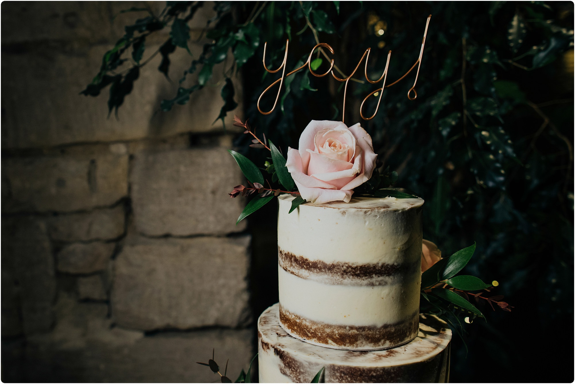 wire cake topper saying yay at a Cripps Barn Winter Wedding