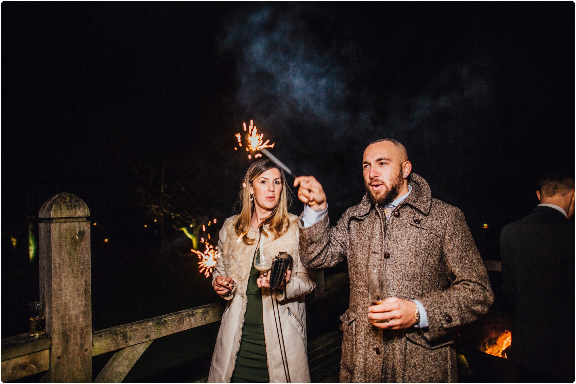 guests playing with sparklers outside at a Cripps Barn Winter Wedding