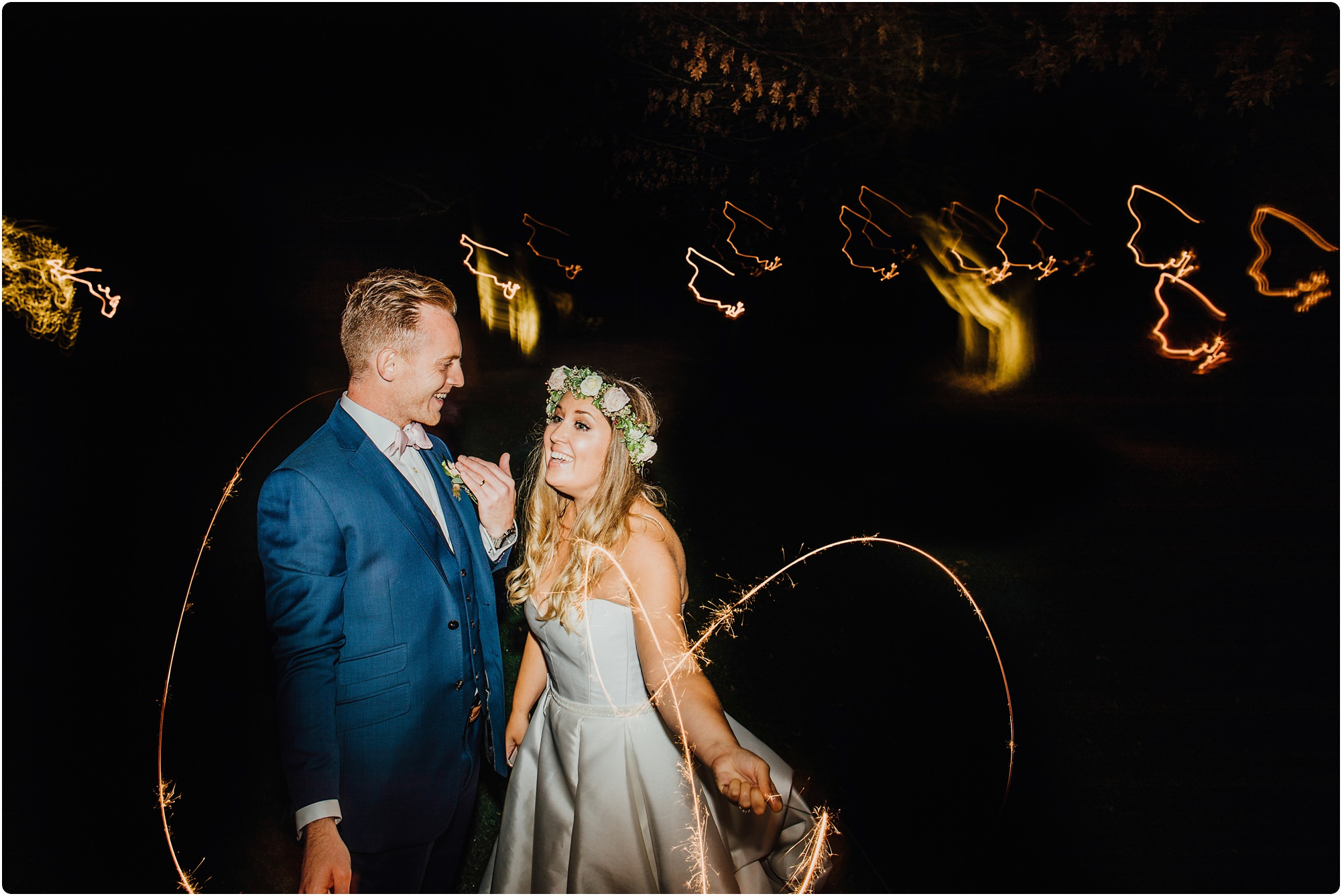 bride and groom doing sparklers at a Cripps Barn Winter Wedding