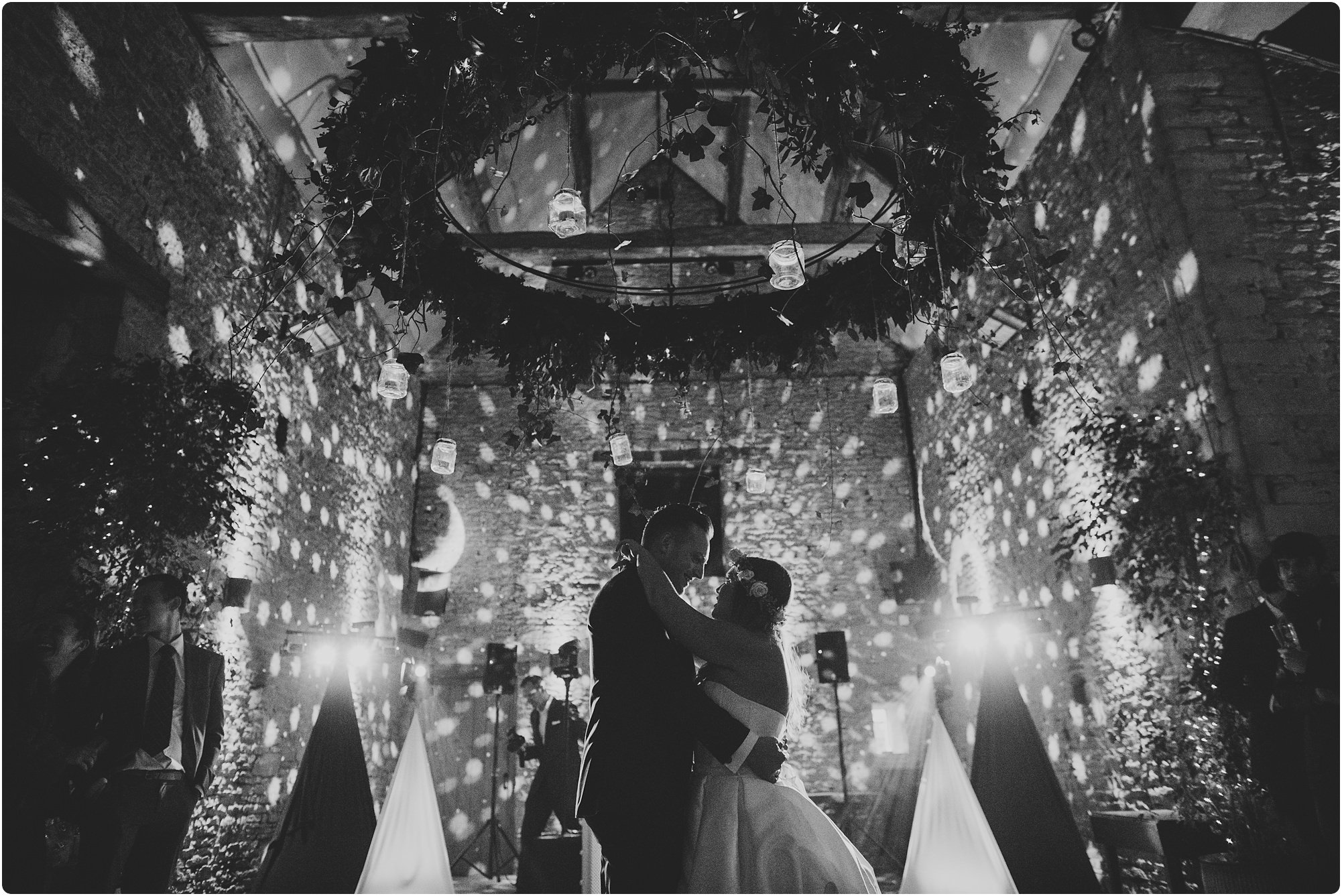 bride and groom first dance in black and white at a Cripps Barn Winter Wedding