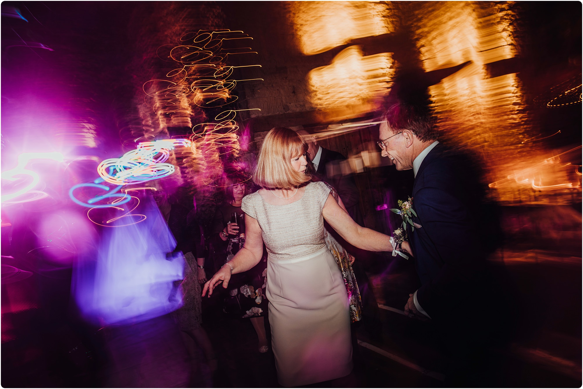 mother of the groom dancing at a Cripps Barn Winter Wedding