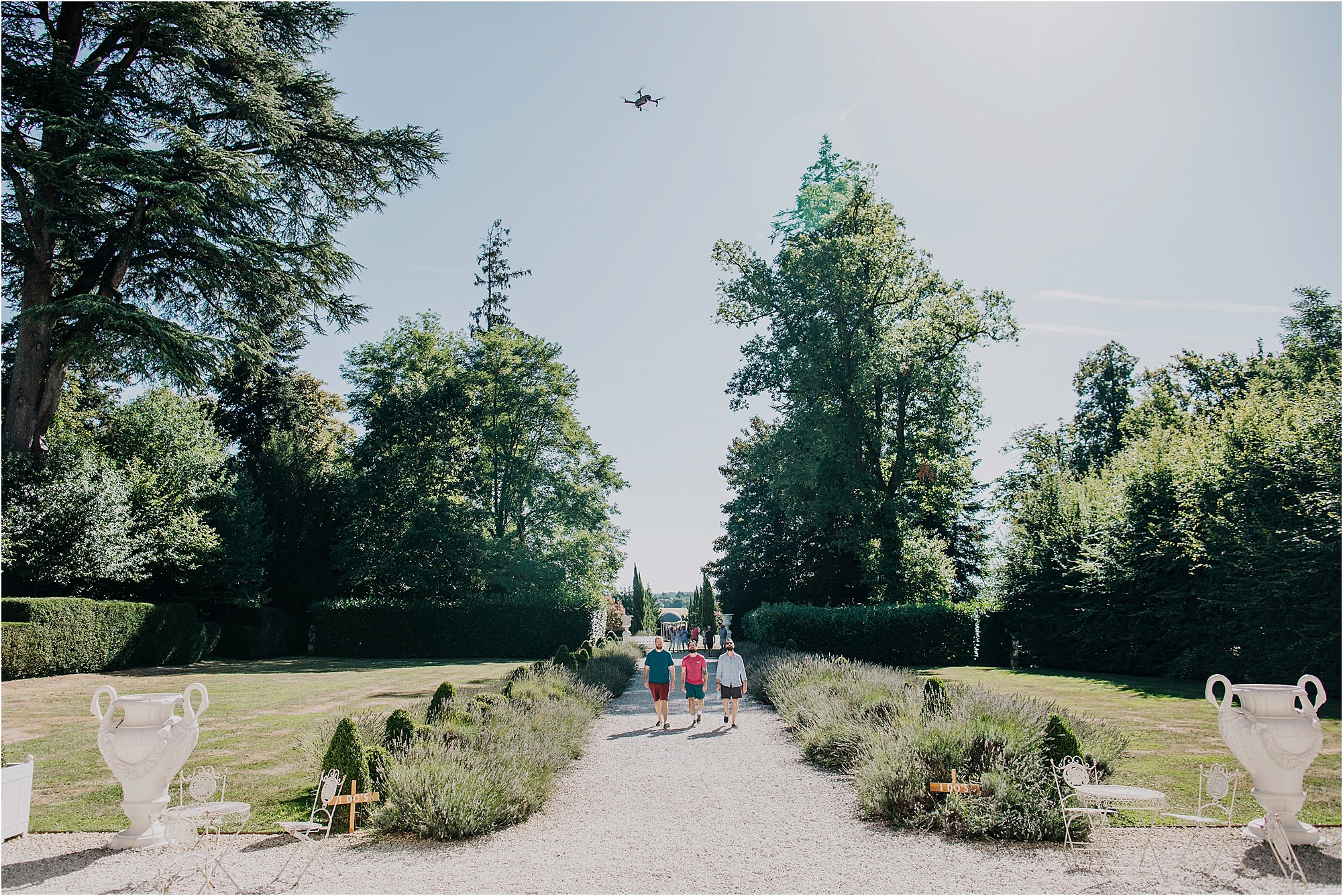 groomsmen walking down the drive at a chateau la durantie wedding with drone